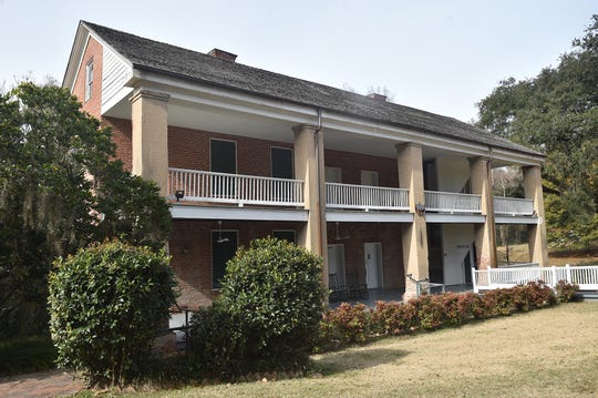 The servants' quarters, where the Nutt family lived during the construction of Longwood, is located behind the home.