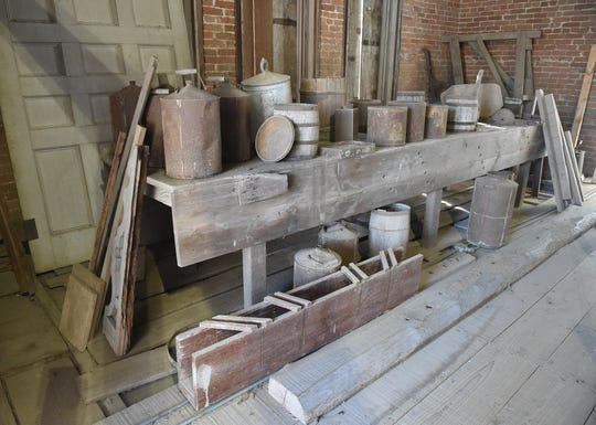 Tools and containers used in construction of Longwood remain on the main floor 156 years after construction ended.