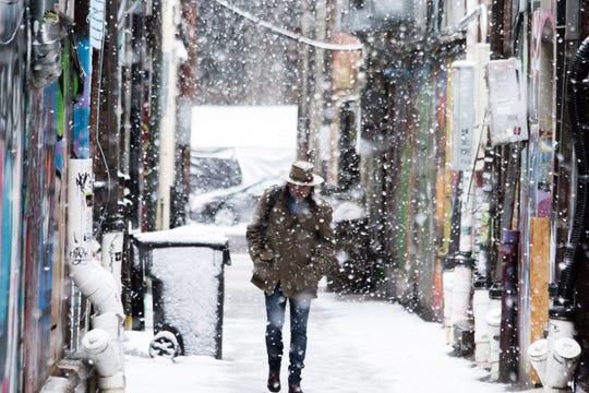 A man walks down Strong Alley on Dec. 9, 2018.