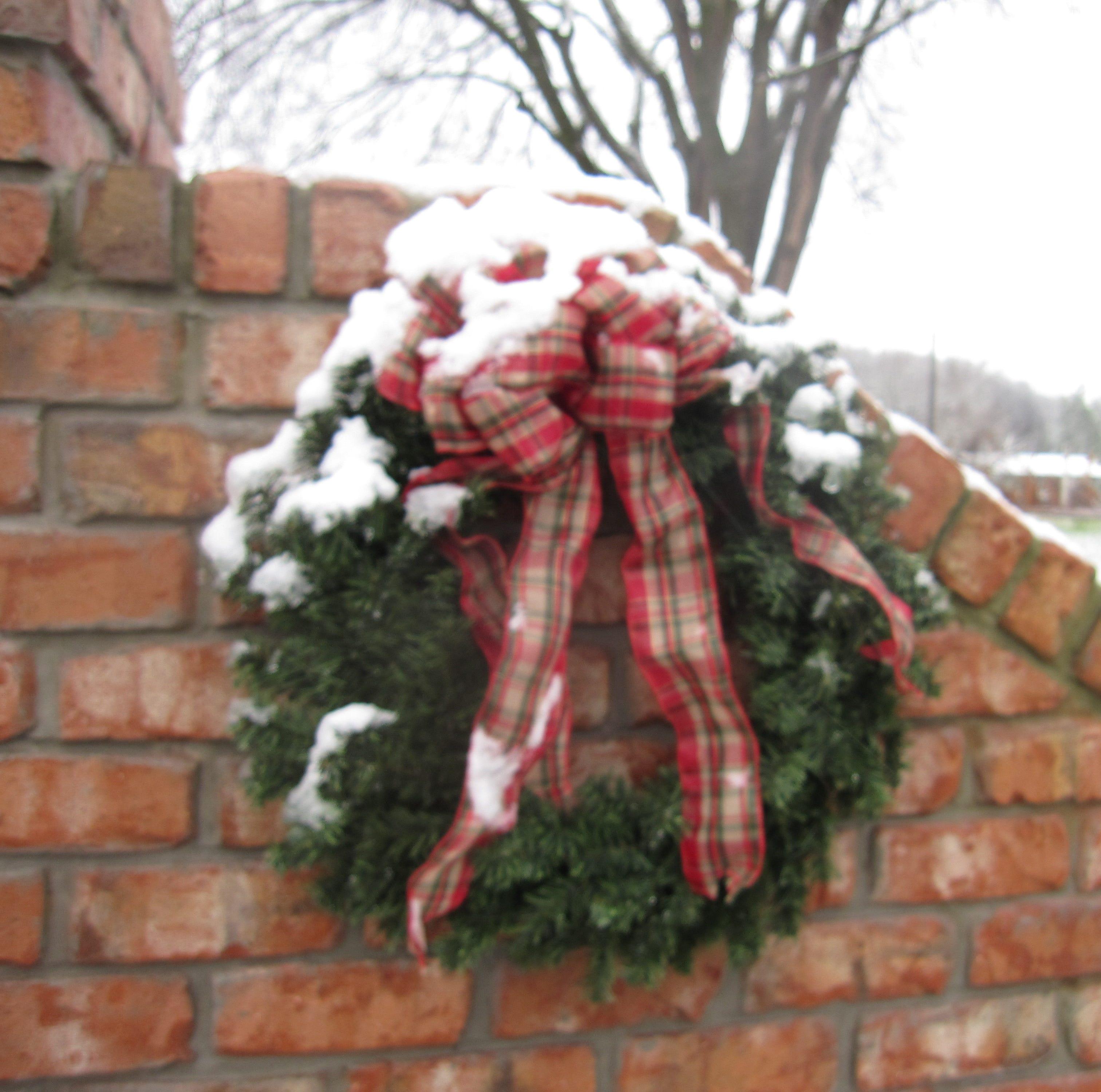 Snow briefly accumulates in Louisville,...