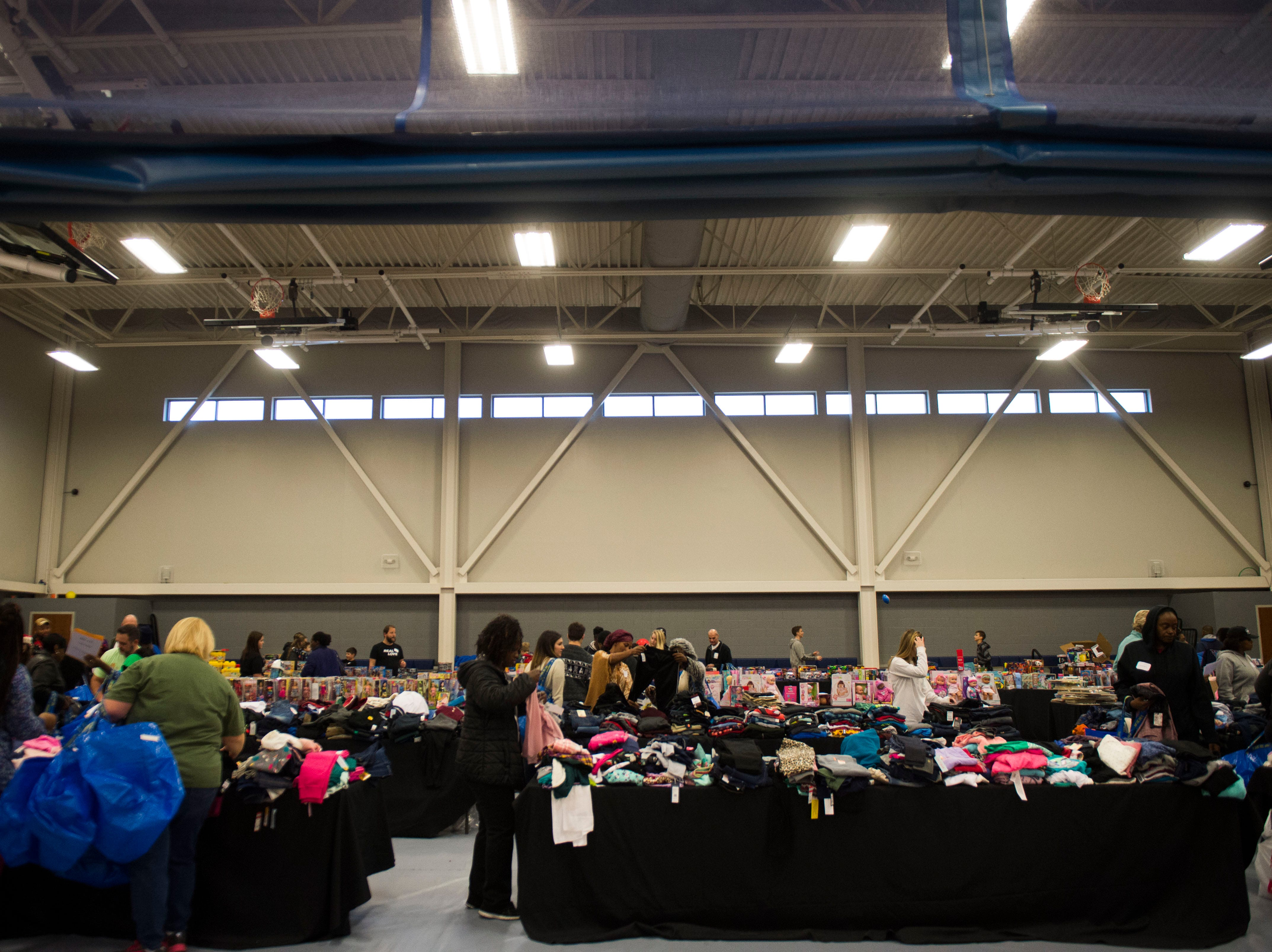 People shop at the Boys and Girls Clubs Regal Teen Center in Knoxville Saturday, Dec. 8, 2018. Parents, grandparents or guardians of over 1,500 underserved children were able to pick out a limited number of free gifts for their child.
