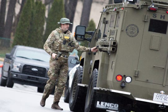 An officer parks a SWAT vehicle as officers prepare to make contact with a man during a fatal standoff at a Blount County apartment complex on Saturday. The man was shot at by officers before shooting himself.
