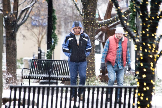 The first snow of the year blankets downtown Knoxville on Dec. 9, 2018.