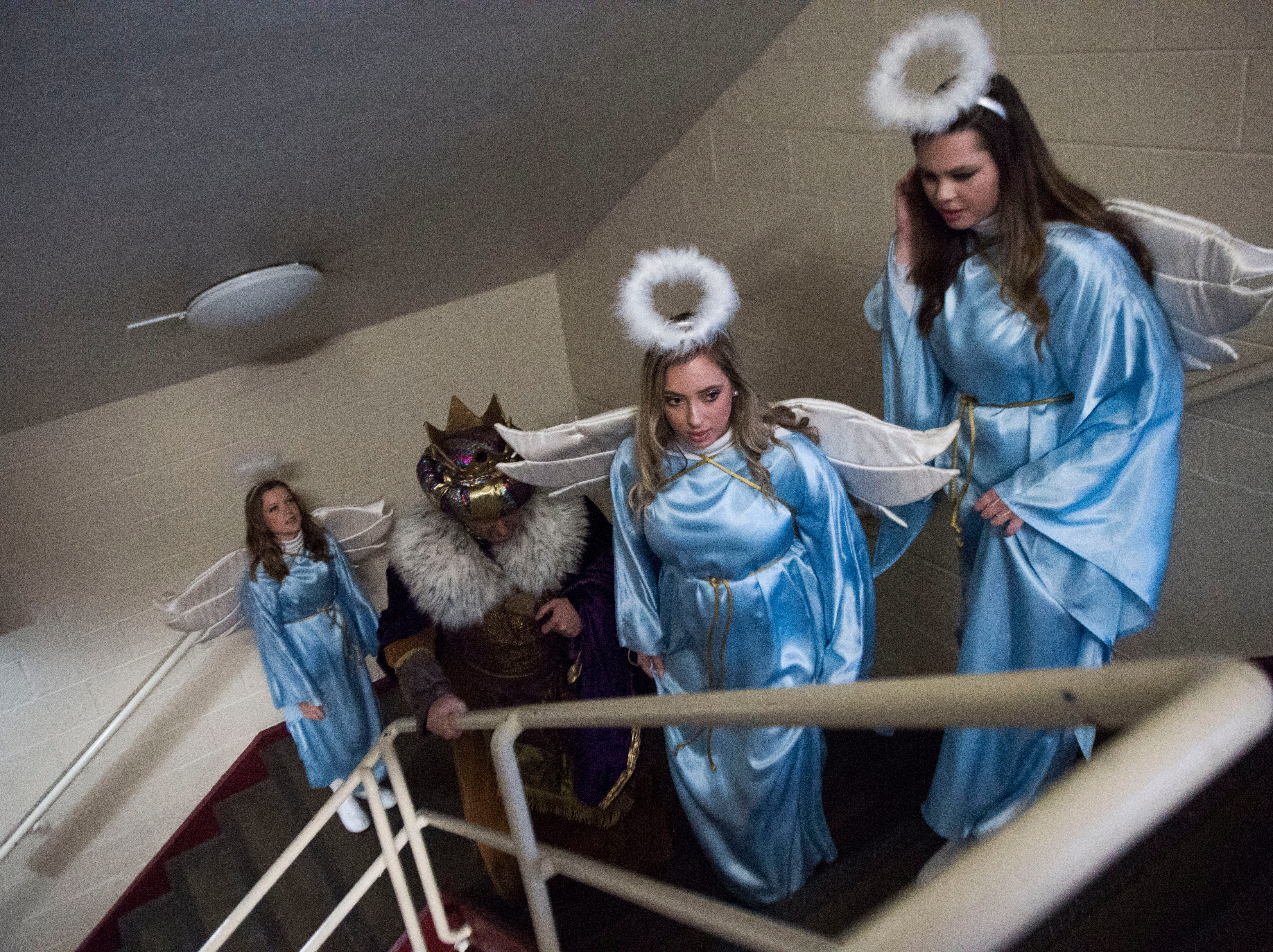 Angels and a king leave the annual Knoxville Nativity Pageant at the Civic Coliseum Saturday, Dec. 8, 2018.