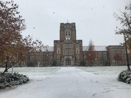 Snowflakes fly around Ayres Hall on the University of Tennessee, Knoxville's campus.
