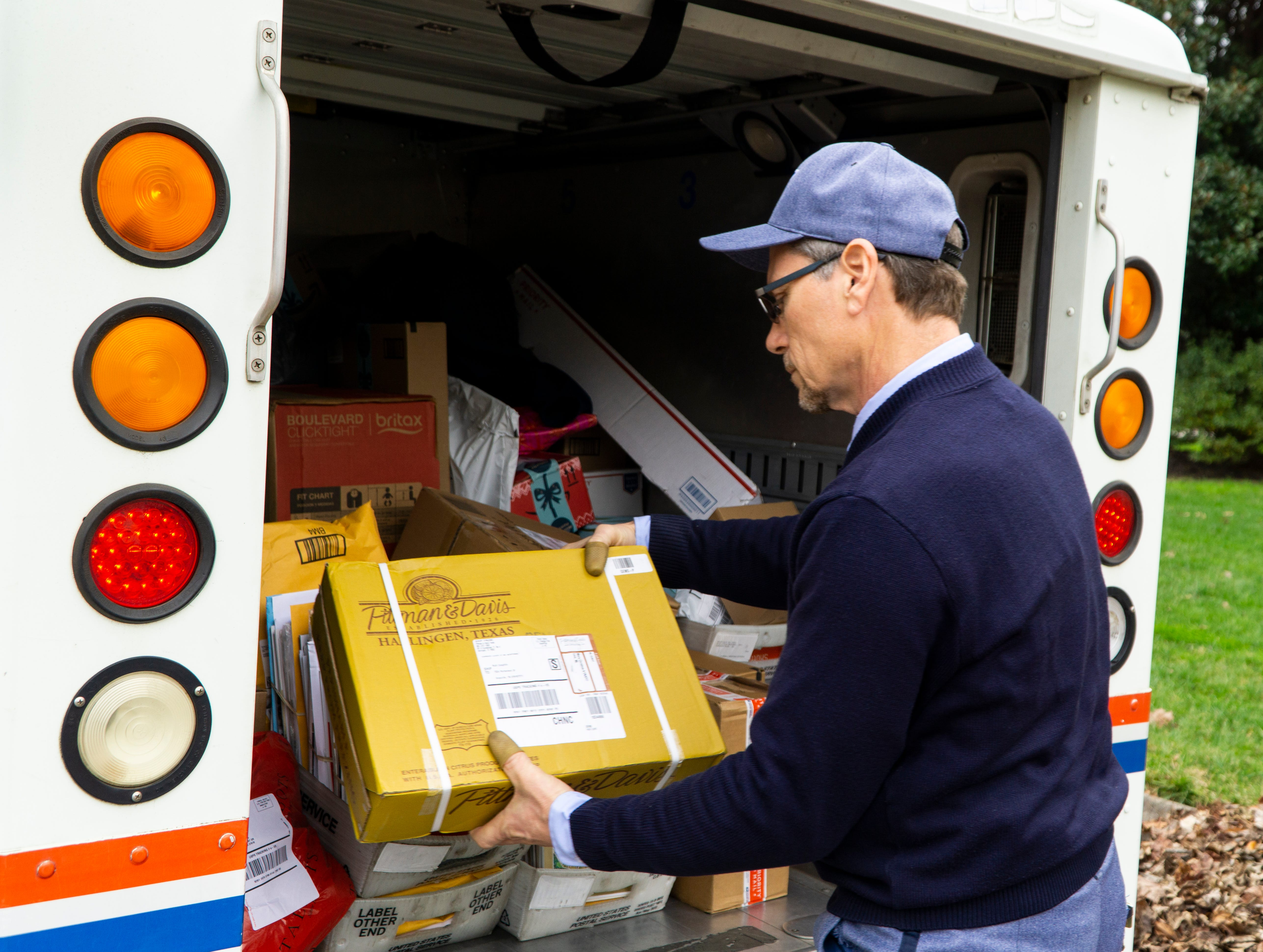 Bryan Lay checks the delivery address while delivering a package on Friday, Dec. 7. Incorrect addresses are some of the most frequent causes of delivery delays during the holiday season.