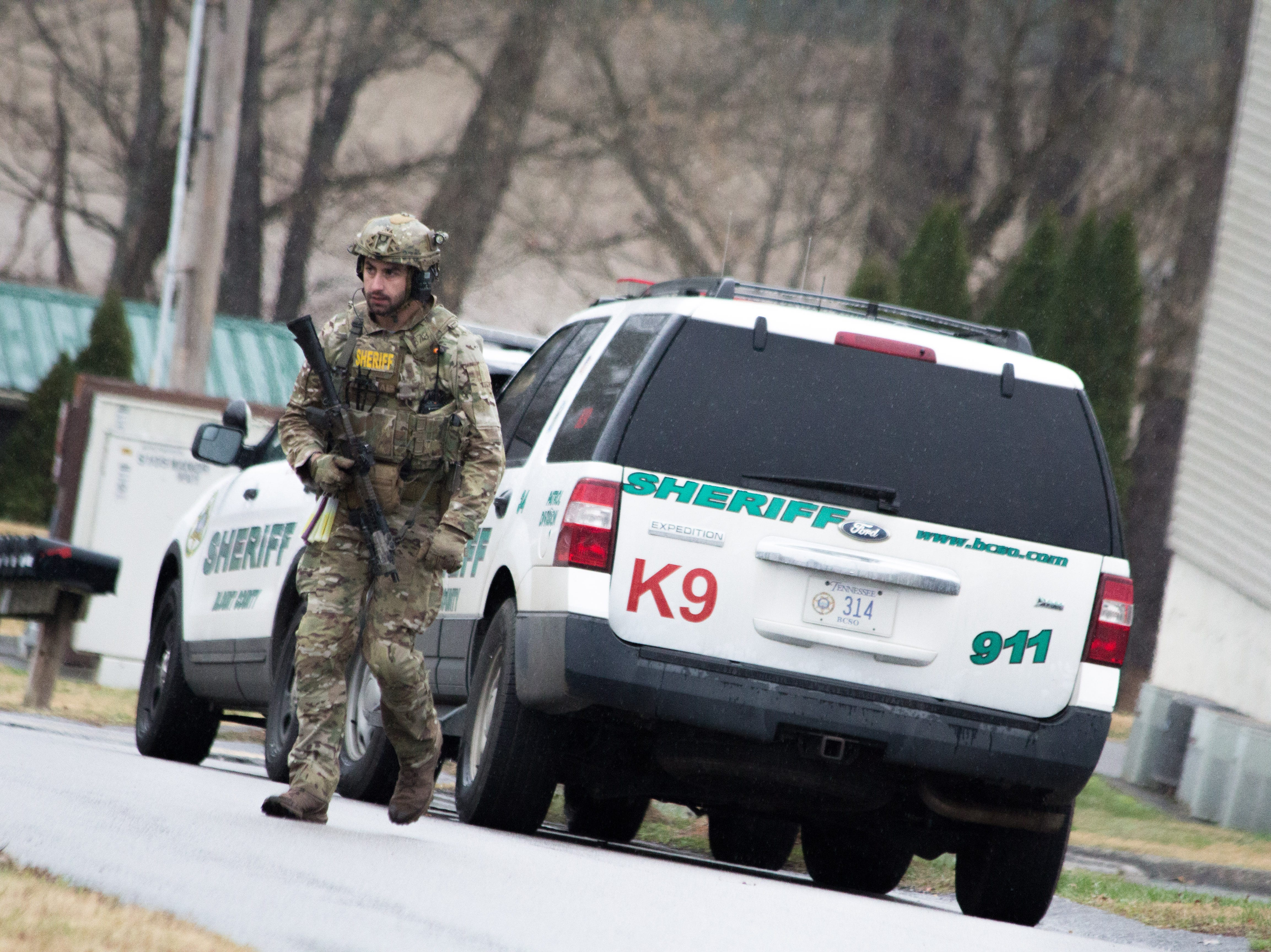 An officer stands near the scene of a standoff between the Blount County Sheriff's Office and a 21-year-old man, who was killed following shots from officers and a self-inflicted wound on Dec. 8, 2018.