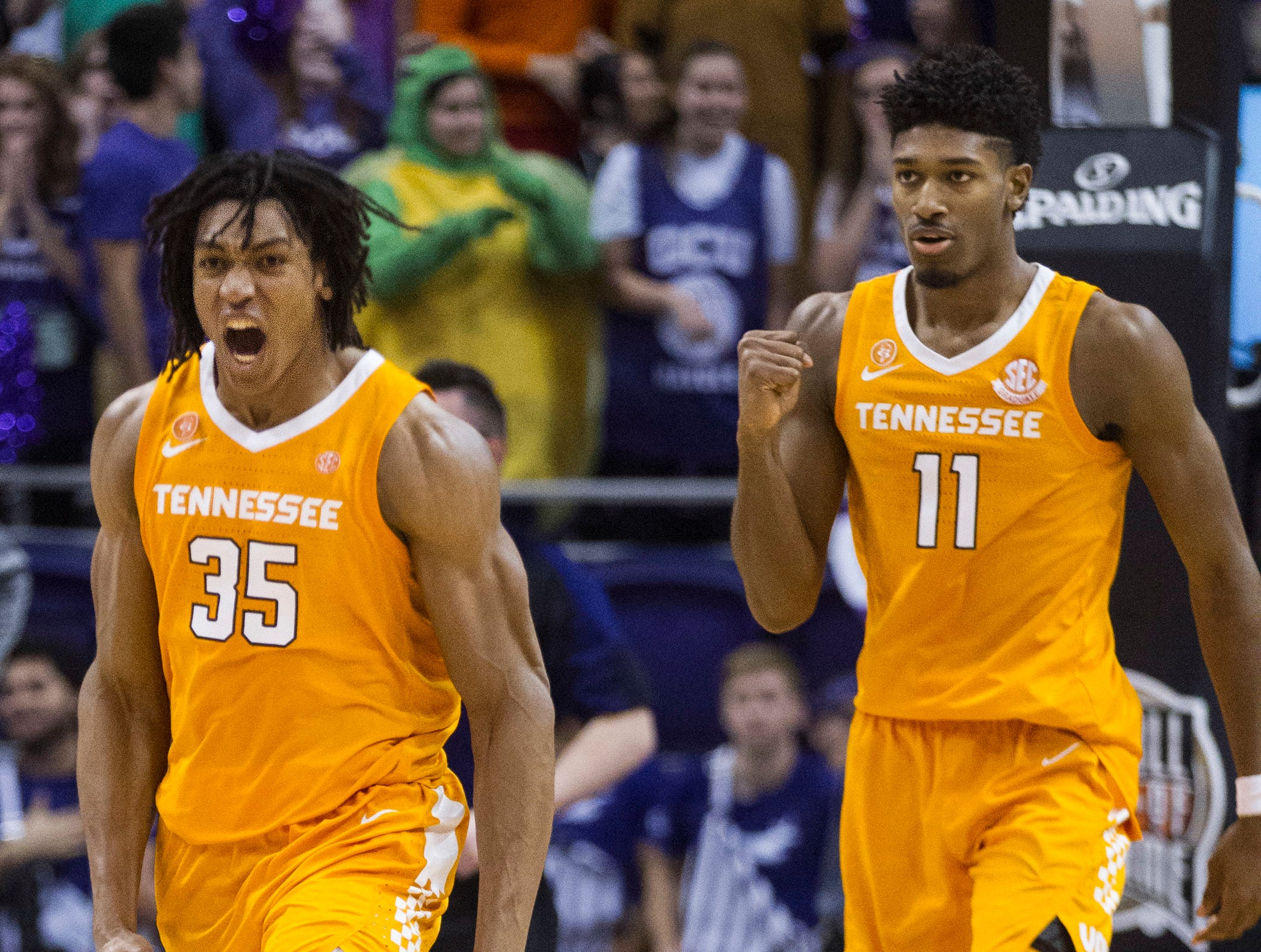 Tennessee's Yves Pons (35) and Kyle Alexander (11) celebrate their win over Gonzaga in an NCAA college basketball game Sunday, Dec. 9, 2018, in Phoenix.