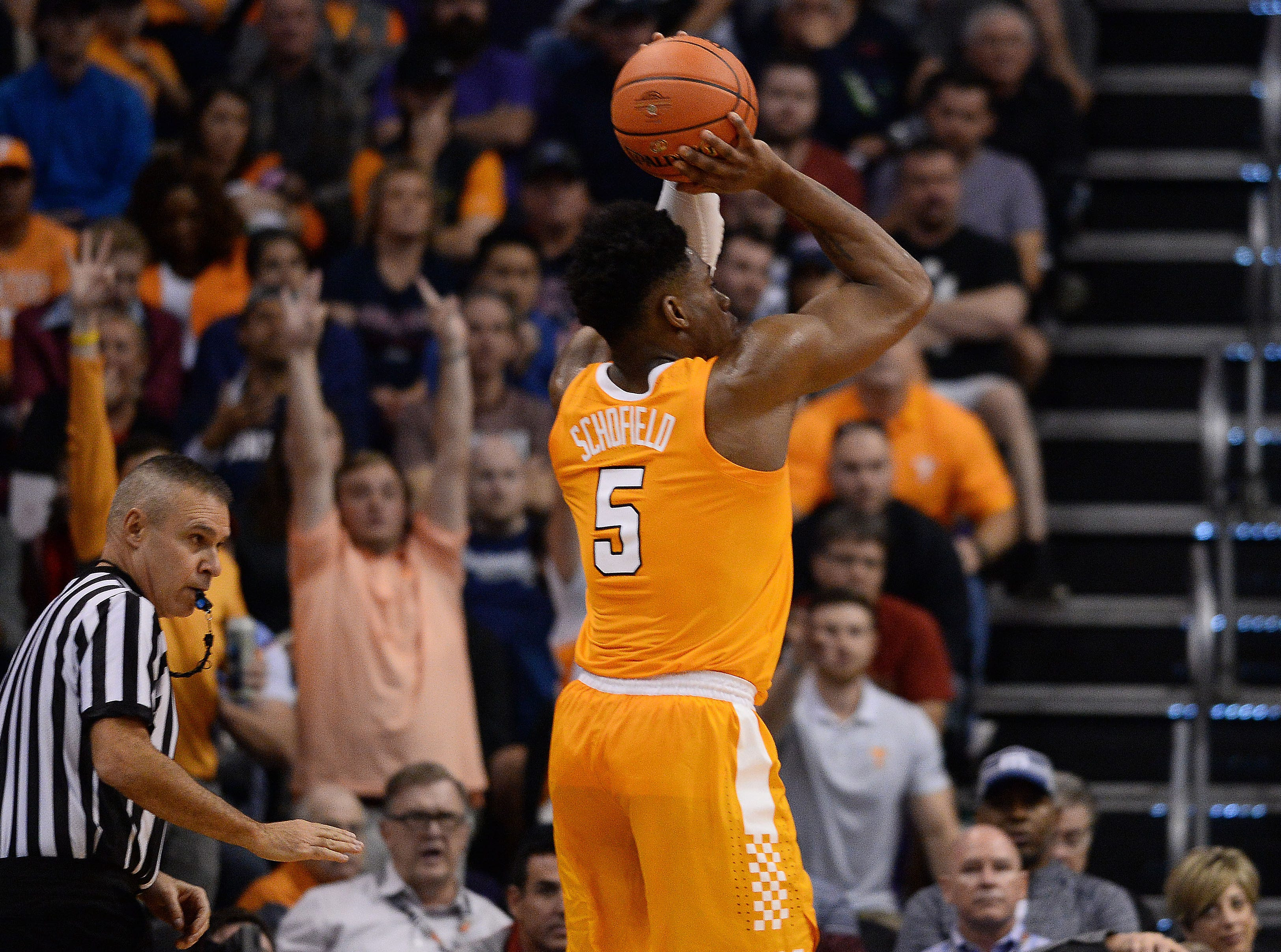 Dec 9, 2018; Phoenix, AZ, USA; Tennessee Volunteers guard Admiral Schofield (5) shoots and makes a three point basket against the Gonzaga Bulldogs during the second half at Talking Stick Resort Arena.