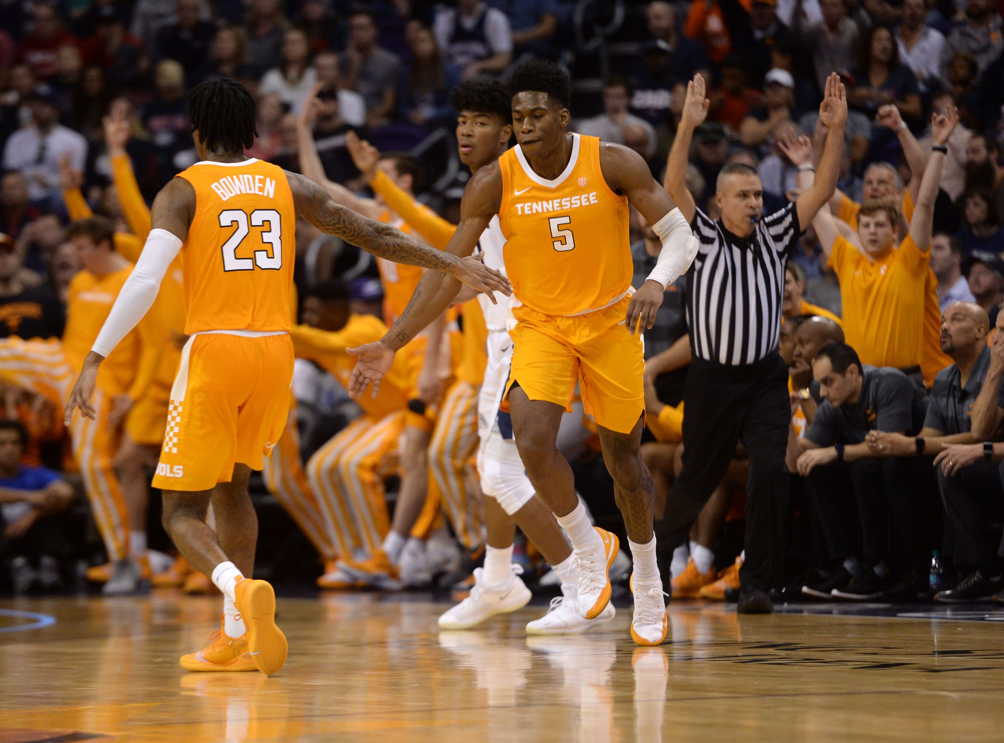 Dec 9, 2018; Phoenix, AZ, USA; Tennessee Volunteers guard Admiral Schofield (5) slaps hands with Tennessee Volunteers guard Jordan Bowden (23) after making a three point basket against the Gonzaga Bulldogs during the second half at Talking Stick Resort Arena.
