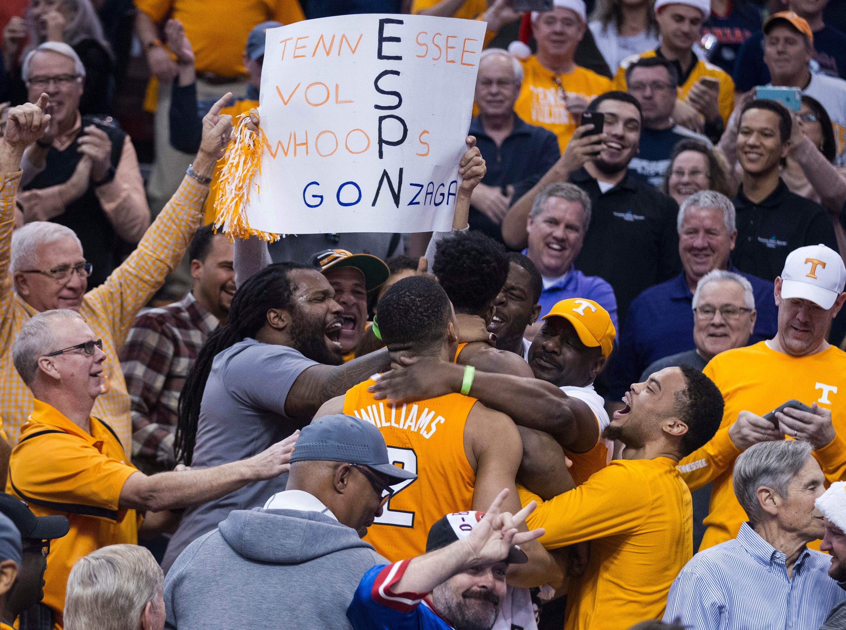Tennessee's Admiral Schofield (5) and Grant Williams (2) goes into the crowd to celebrate with fans their win over Gonzaga in an NCAA college basketball game Sunday, Dec. 9, 2018, in Phoenix.