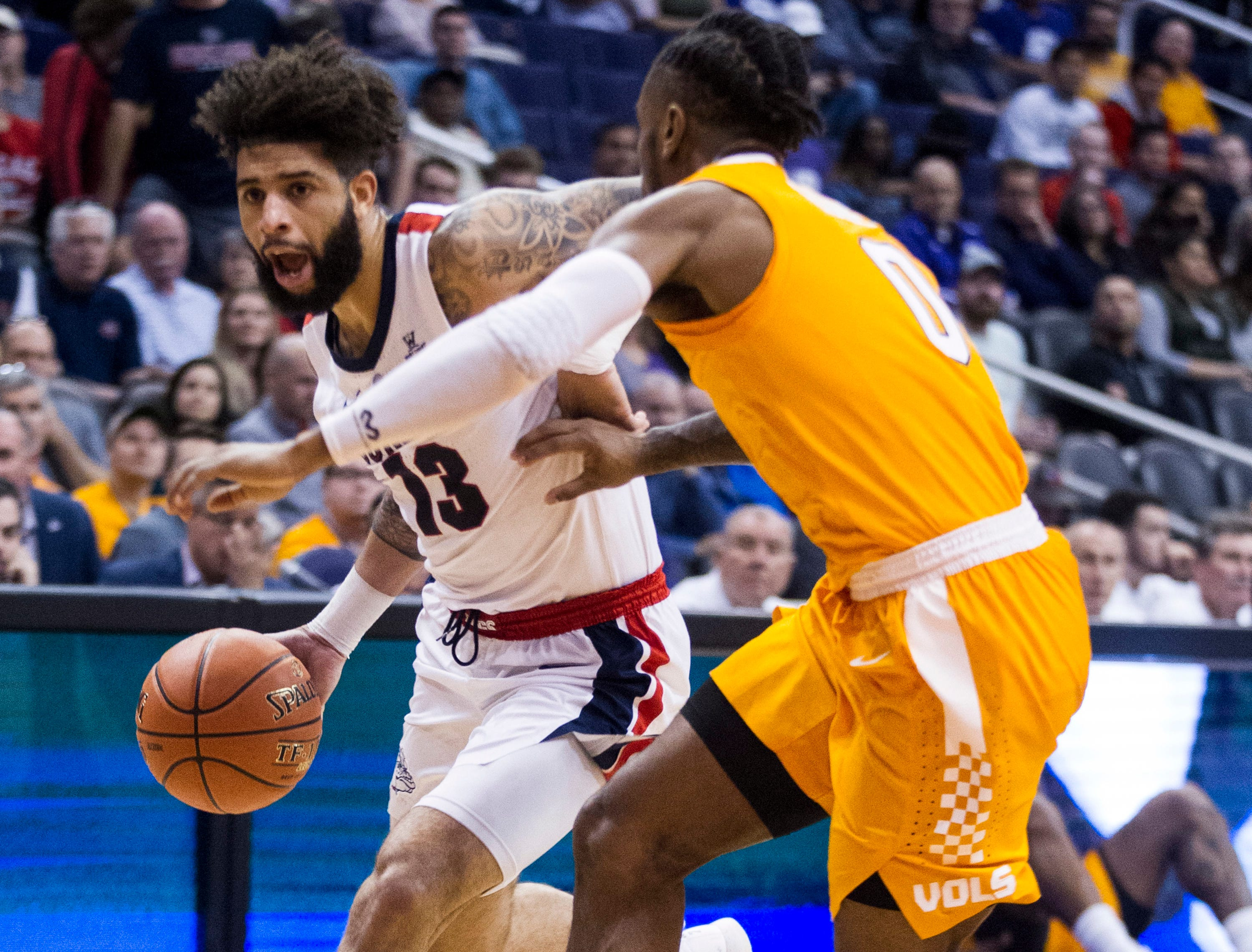 Gonzaga's Josh Perkins drives to the basket against Tennessee's Jordan Bone during the first half of an NCAA college basketball game Sunday, Dec. 9, 2018, in Phoenix.