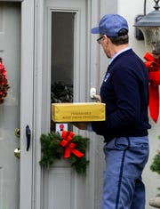 FILE: Bryan Lay delivers a package to a West Knoxville home Dec. 7, 2018.