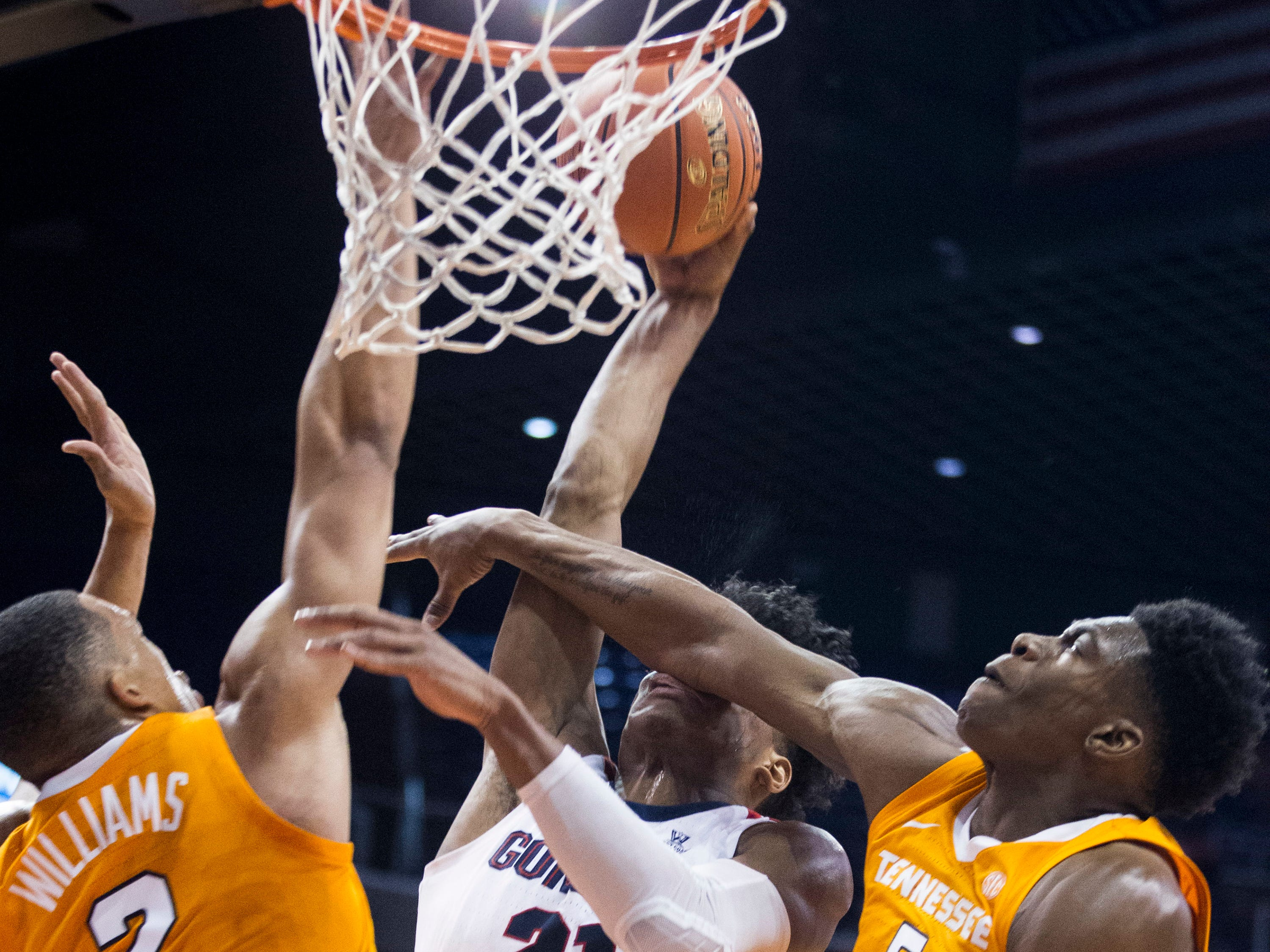Gonzaga's Rui Hachimura (21) is fouled by Tennessee's Admiral Schofield (5) and Grant Williams (2) during the first half of an NCAA college basketball game Sunday, Dec. 9, 2018, in Phoenix.
