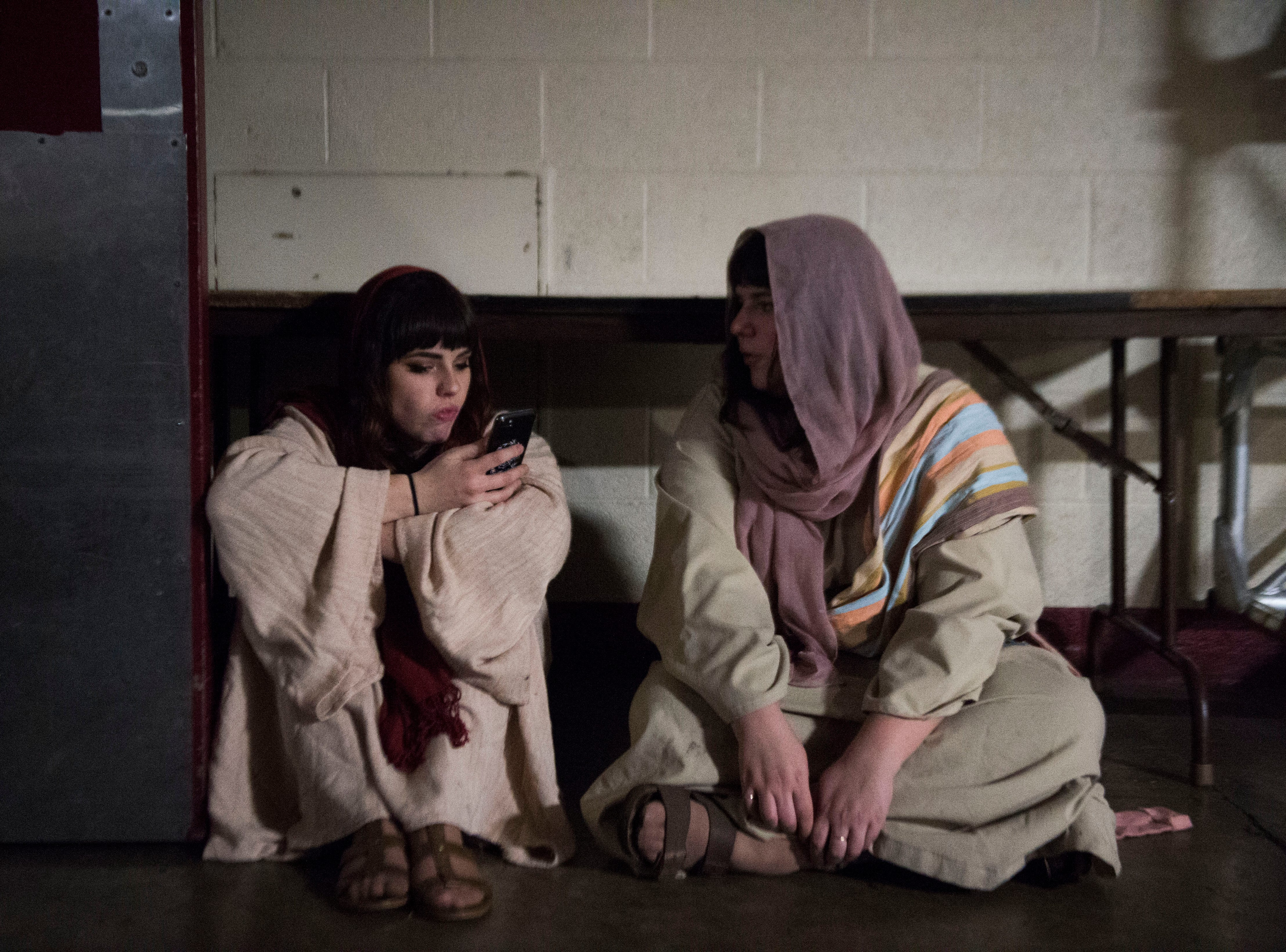 From left, sisters Maranda and Lisa Vandergriff wait for the annual Knoxville Nativity Pageant to begin at the Civic Coliseum Saturday, Dec. 8, 2018.