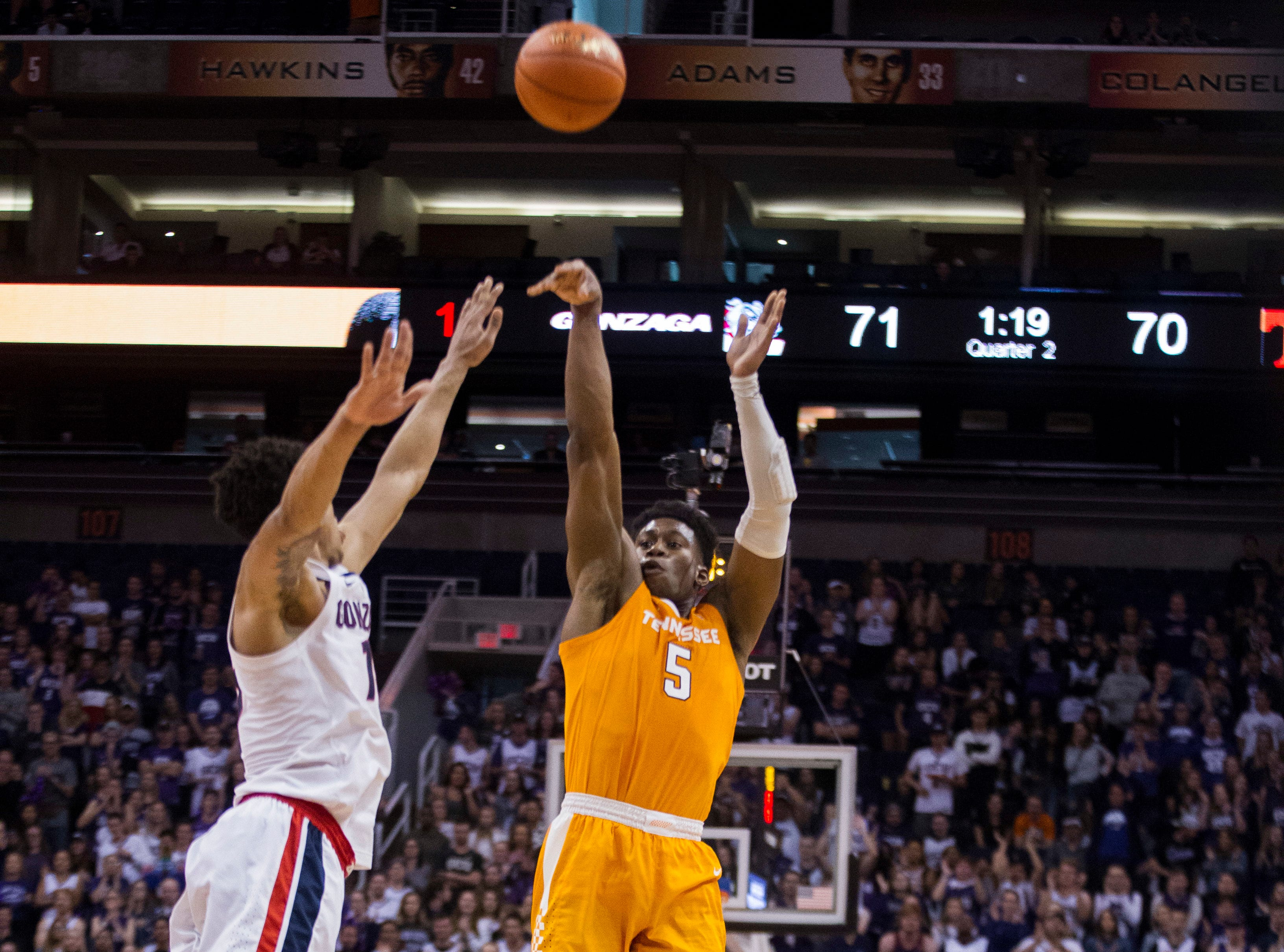 Tennessee's Admiral Schofield (5) puts up a go-ahead shot against Gonzaga's Brandon Clarke (15) during the second half of an NCAA college basketball game Sunday, Dec. 9, 2018, in Phoenix.