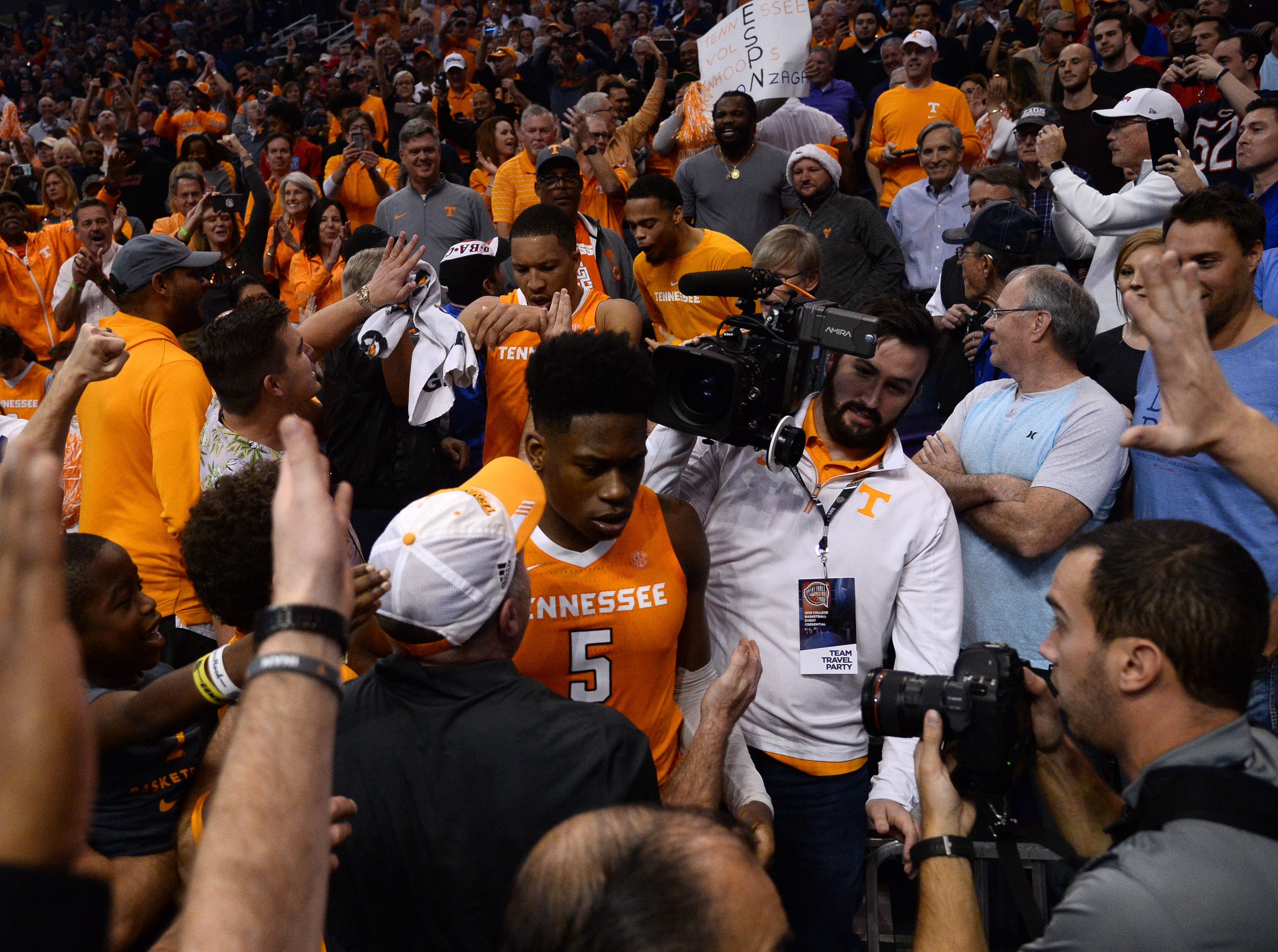 Dec 9, 2018; Phoenix, AZ, USA; Tennessee Volunteers forward Grant Williams (2) and Tennessee Volunteers guard Admiral Schofield (5) celebrate in the stands after defeating Gonzaga Bulldogs at Talking Stick Resort Arena.