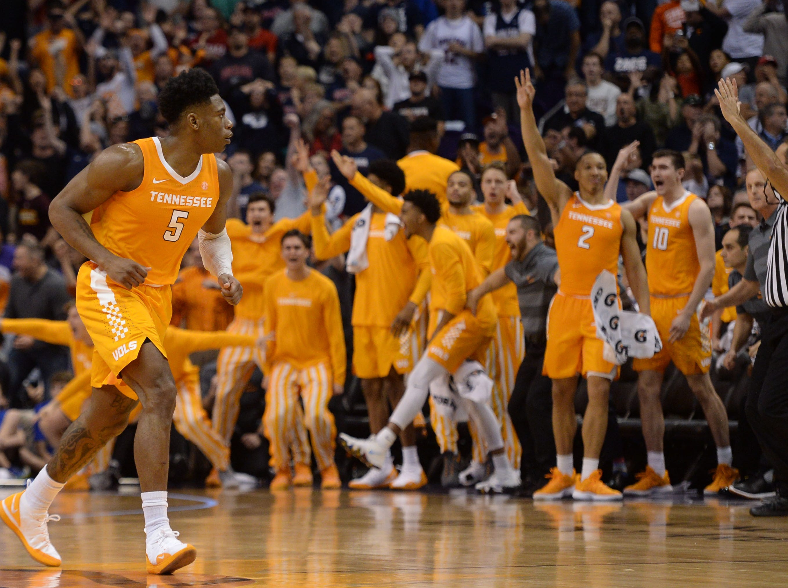 Dec 9, 2018; Phoenix, AZ, USA; Tennessee Volunteers guard Admiral Schofield (5) and the bench celebrate the go ahead three point basket against the Gonzaga Bulldogs during the second half at Talking Stick Resort Arena.