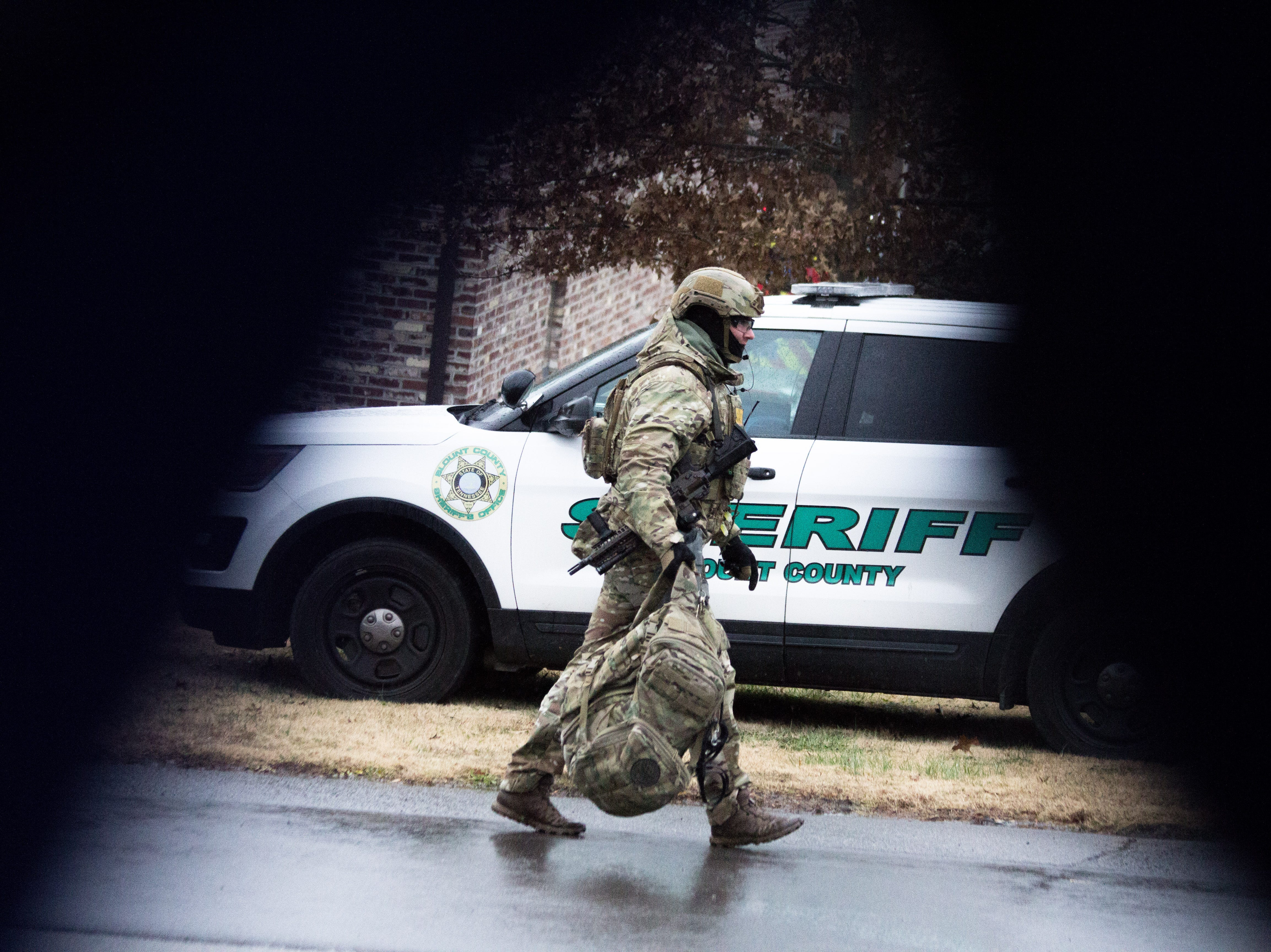 A member of the Blount County SWAT team walks toward the scene of a standoff just before officers fired shots at a man who came out with a gun. The man then shot himself and died Dec. 8, 2018.