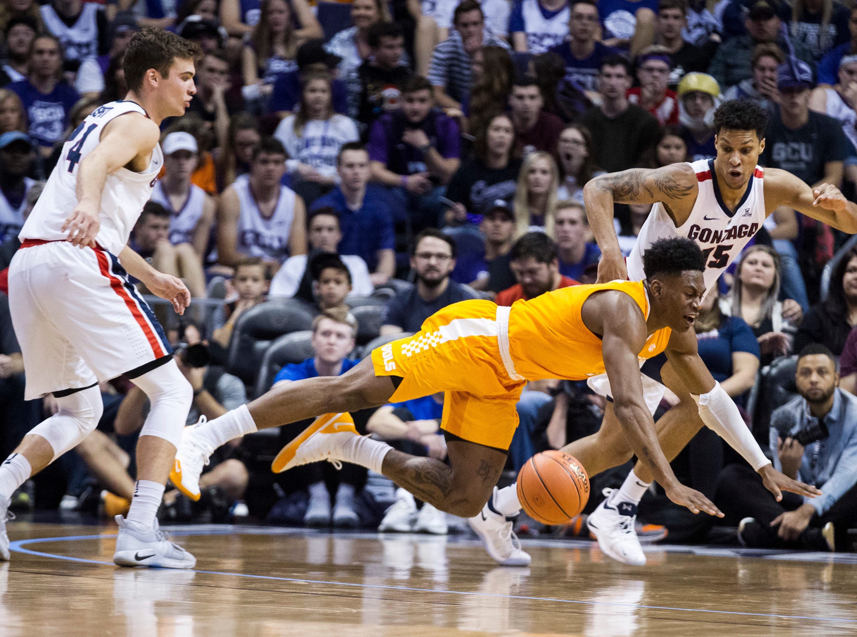 Tennessee's Admiral Schofield (5) loses the ball against Gonzaga's Corey Kispert (24) and Brandon Clarke (15) during the first half of an NCAA college basketball game Sunday, Dec. 9, 2018, in Phoenix.