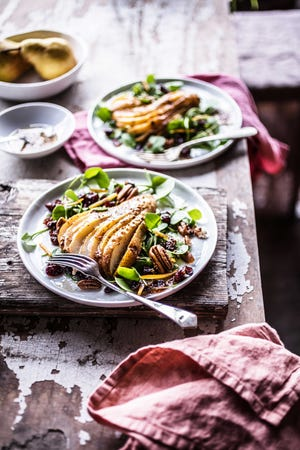 """Watercress, pear and pecan salad with candied cranberries. Photo from """"Back to the Cutting Board"""" by Christina Pirello."""