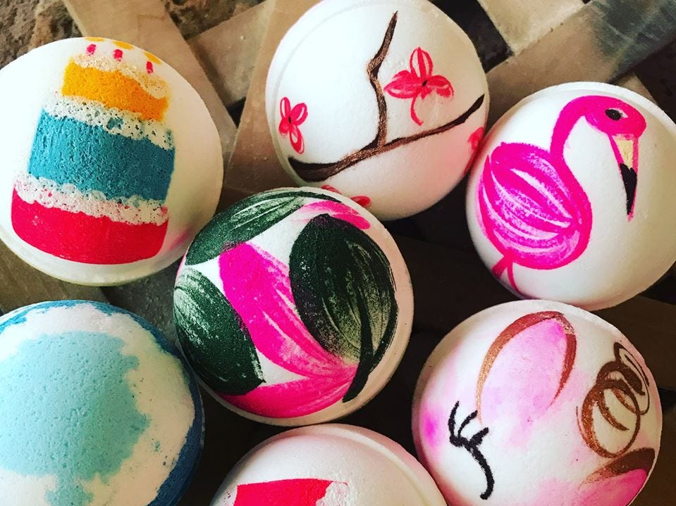 One of a kind, hand painted bath bombs sold at Caroline and Company