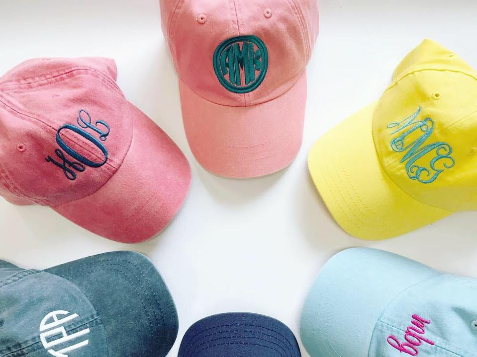 Customized hats sold at Absolutely Custom Apparel & Graphics