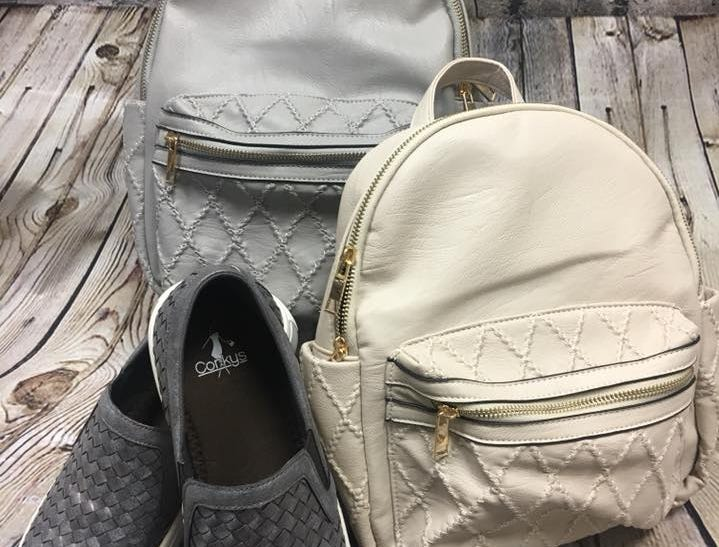 Fine bags and shoes sold at Farmer's Drugs and Gifts