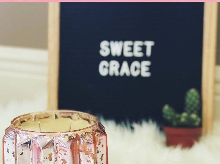 Absolutely Custom Apparel & Graphics has a full line of Sweet Grace candles and detergents.