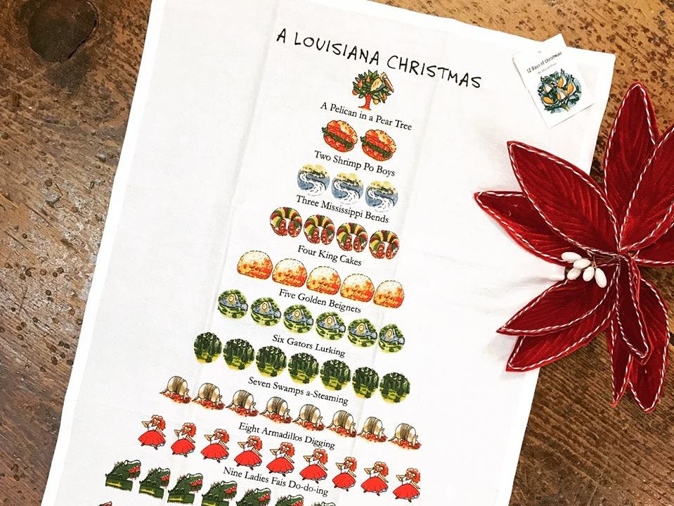 """This """"A Louisiana Christmas"""" kitchen towel is sure to be a hit this season"""