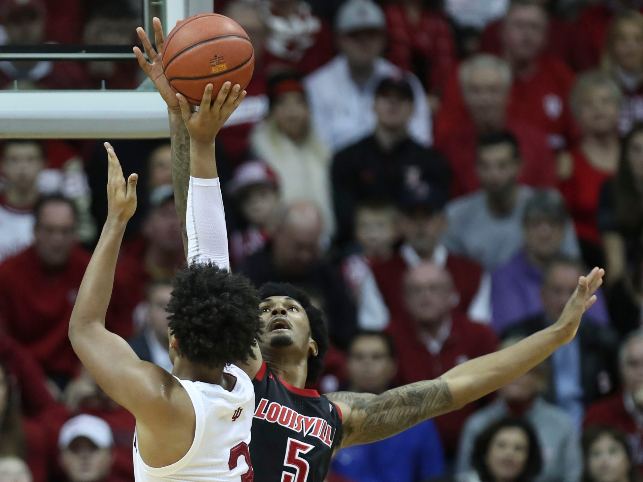 Louisville's Malik Williams blocks the shot of Indiana's Justin Smith's shot Saturday, Dec. 8, 2018.