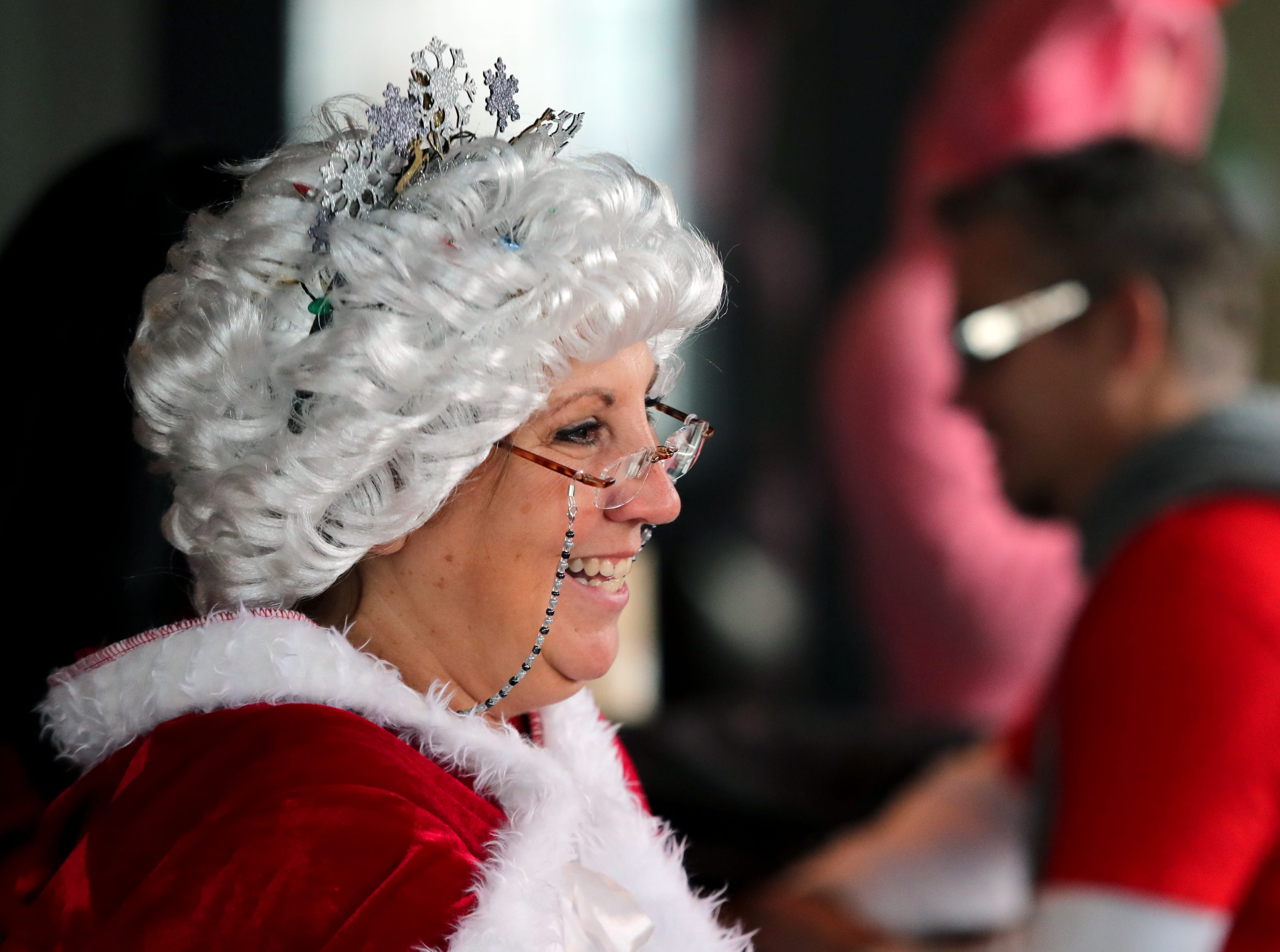 Lisa Robbins enjoys 8 UP, the first location on the Louisville SantaCon journey. Dec. 8, 2018