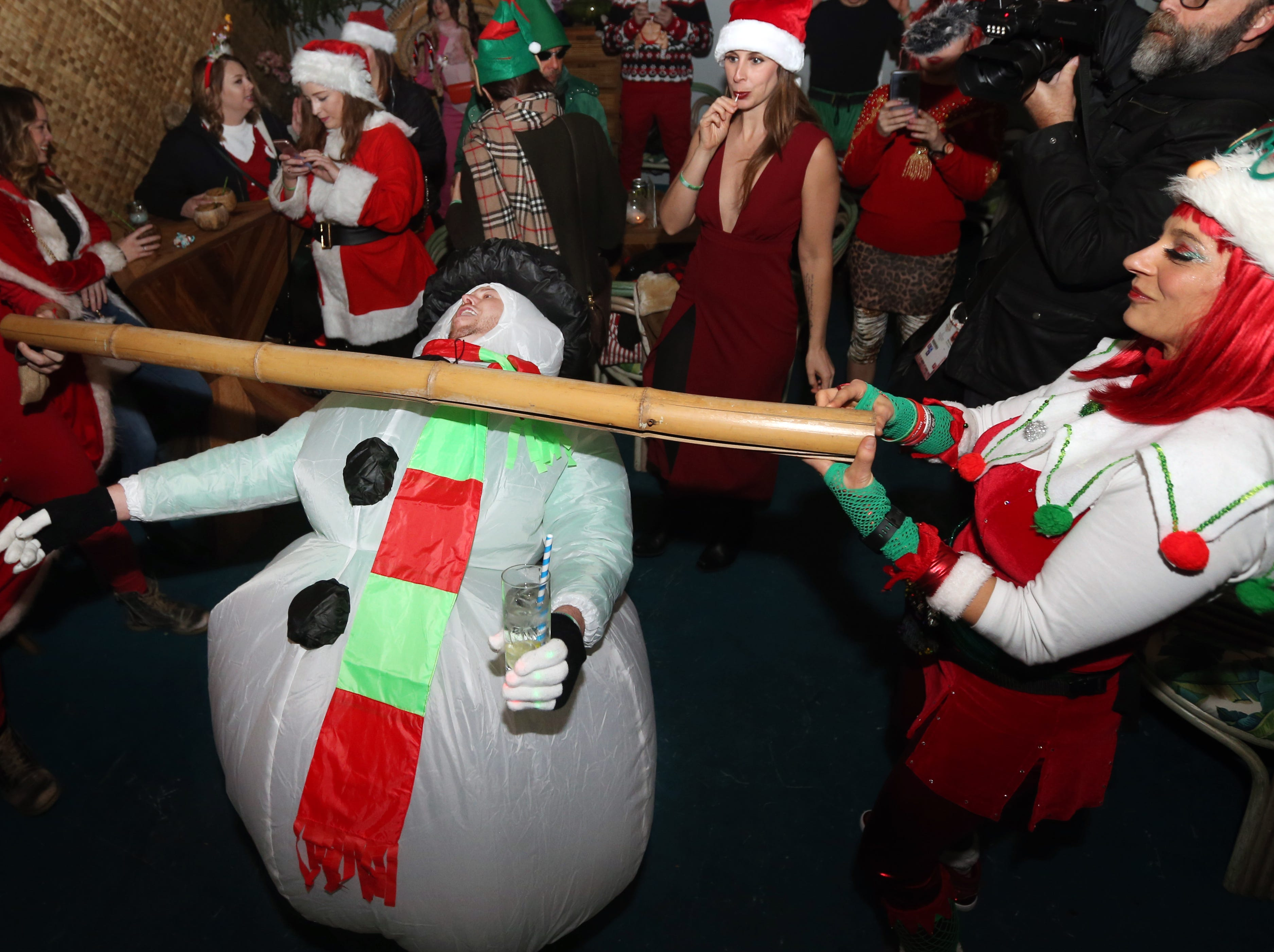 The SantaCon crowd stops by The Limbo Bar and Tiki Lounge on Chestnut. Dec. 8, 2018