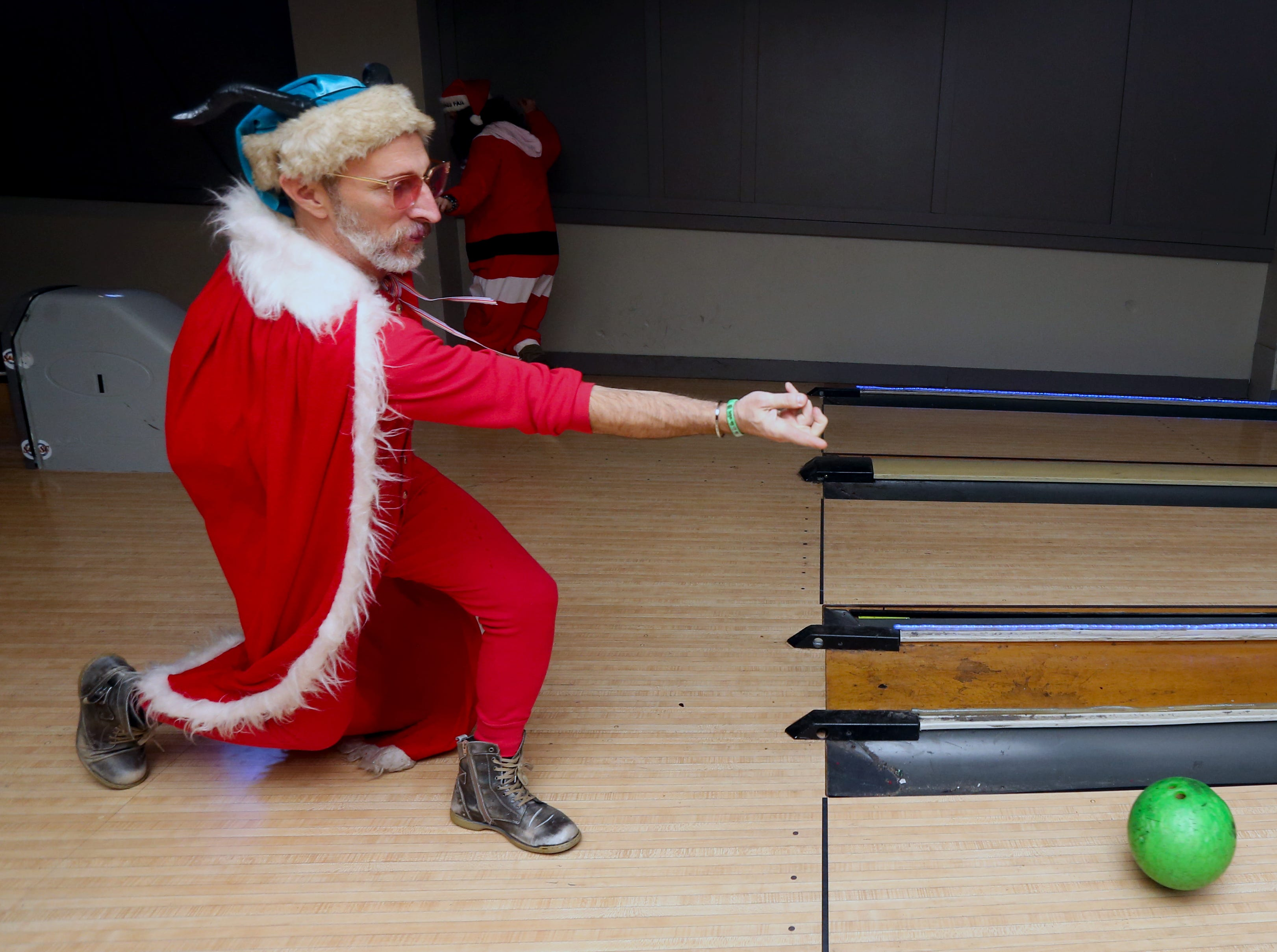 J.D. Dotson bowls at the Sports & Social Club as one of the stops along the SantaCon trail. Dec. 8, 2018