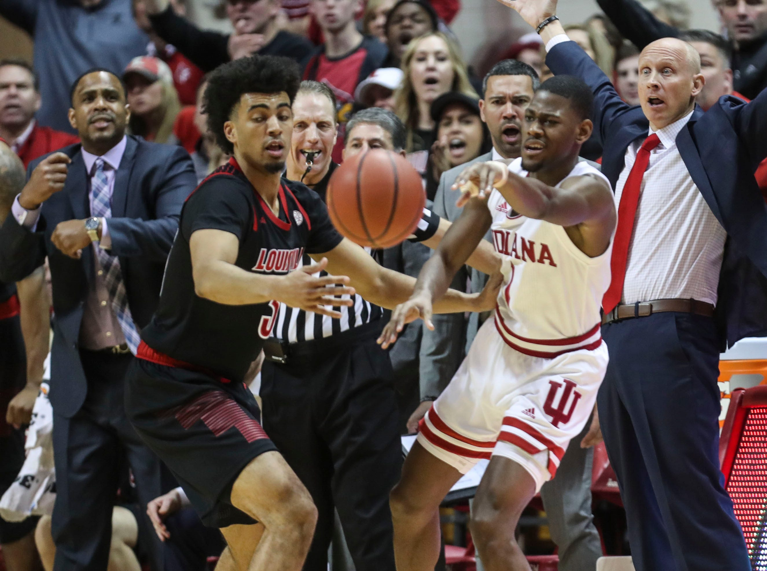 "Louisville's Jordan Nwora pressures Indiana's Aljami Durham Saturday, Dec. 8, 2018. Cardinal coach Chris Mack, seen from the sideline, said afterwards: ""As I told our guys, you're going to have times where even the best teams on offense don't score four or five possessions in a row, and we've got to be able to keep the other team from scoring. We didn't do that."""