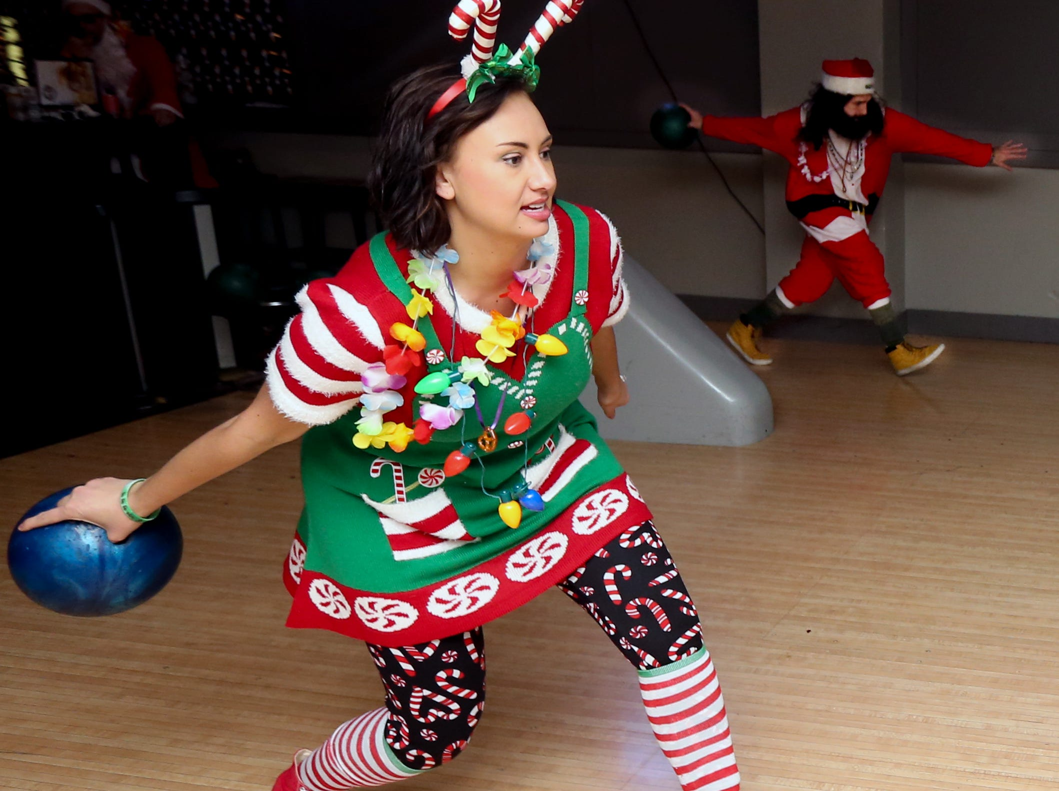 Kelcie Perez bowls at the Sports & Social Club as one of the stops along the SantaCon trail. Dec. 8, 2018