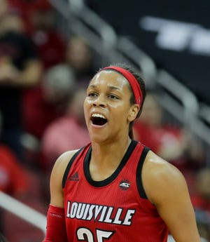 Louisville's Asia Durr is a little frustrated with a no-call from an official. 