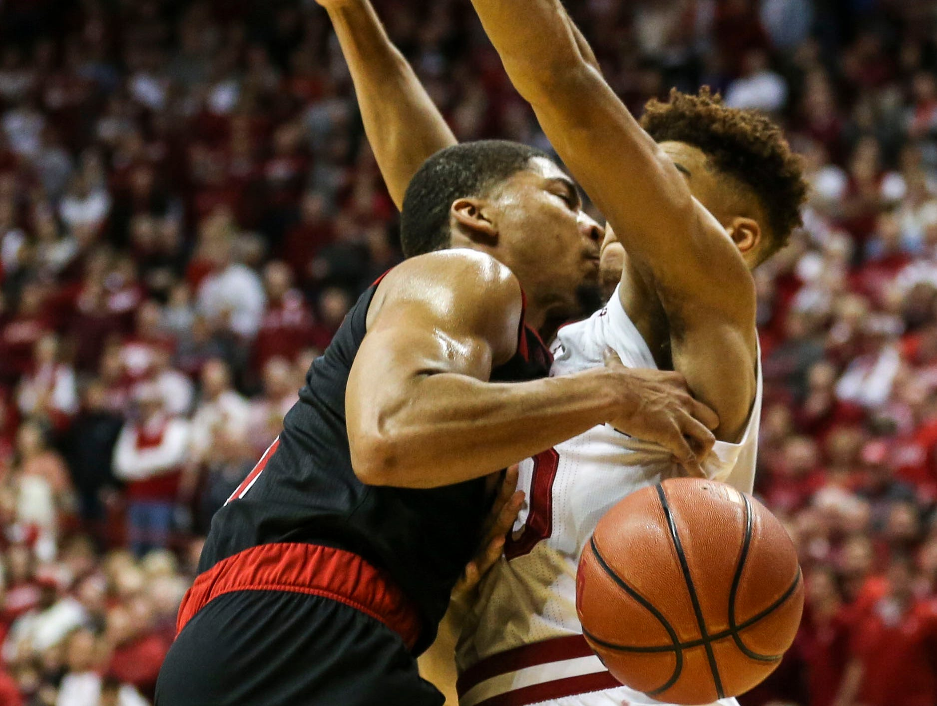 Louisville's Christen Cunningham drives against Indiana's Rob Phinisee Saturday, Dec. 8, 2018. Cunningham finished with 16 points Phinisee had 10 points.