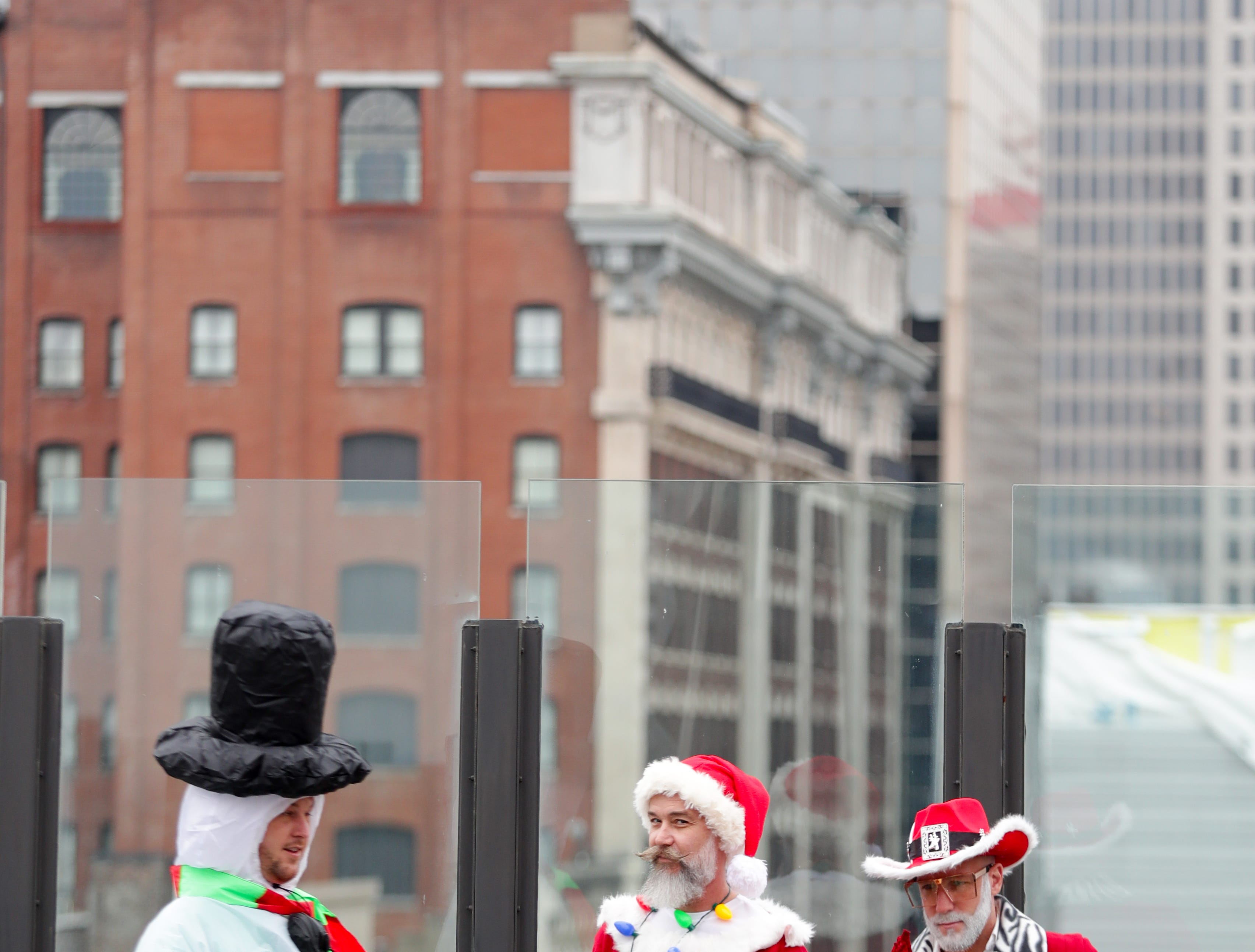 The crowd enjoys 8 UP, the first location on the Louisville SantaCon journey. Dec. 8, 2018