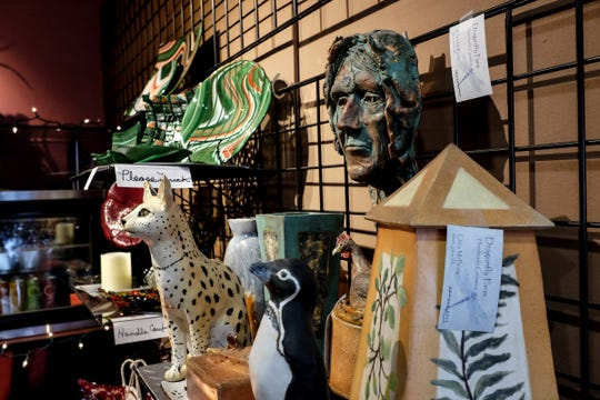 Some of the varied artwork and gifts are on display at the Lansing Eastside Gateway Sunday, Dec. 9, 2018.