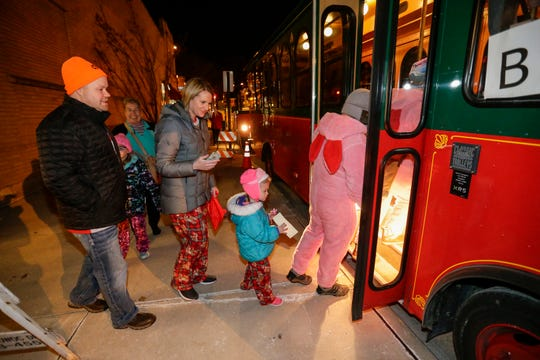 "Kids board a ""magical"" trolley to Santa's North Pole at the Holiday Inn Saturday, December 8, 2018, in Manitowoc, Wis. Proceeds from the event went to Lakeshore CAPS. Joshua Clark/USA TODAY NETWORK-Wisconsin"