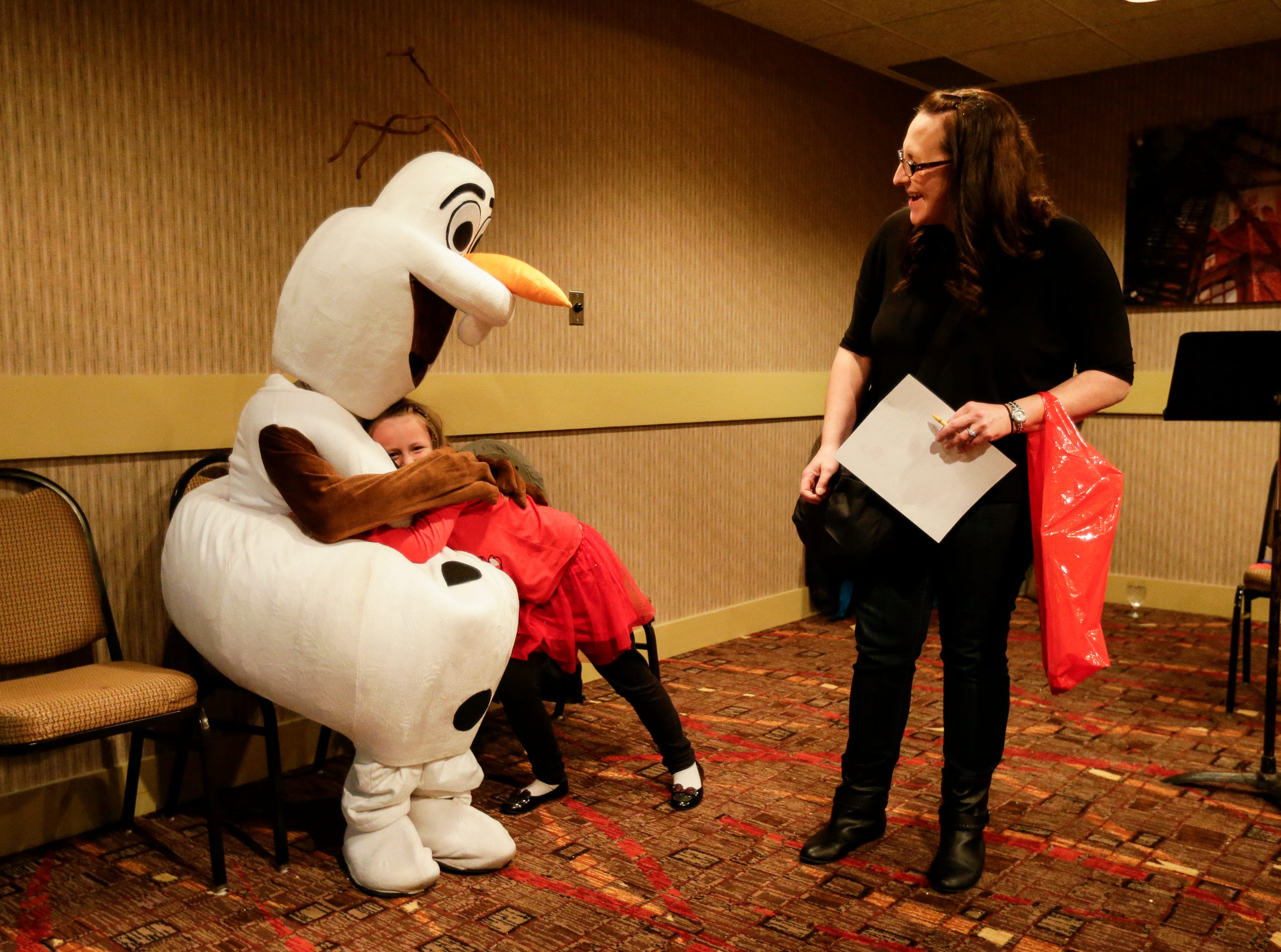 Lily Reimer, 6, hugs Olaf at Santa's North Pole at the Holiday Inn Saturday, December 8, 2018, in Manitowoc, Wis. Joshua Clark/USA TODAY NETWORK-Wisconsin