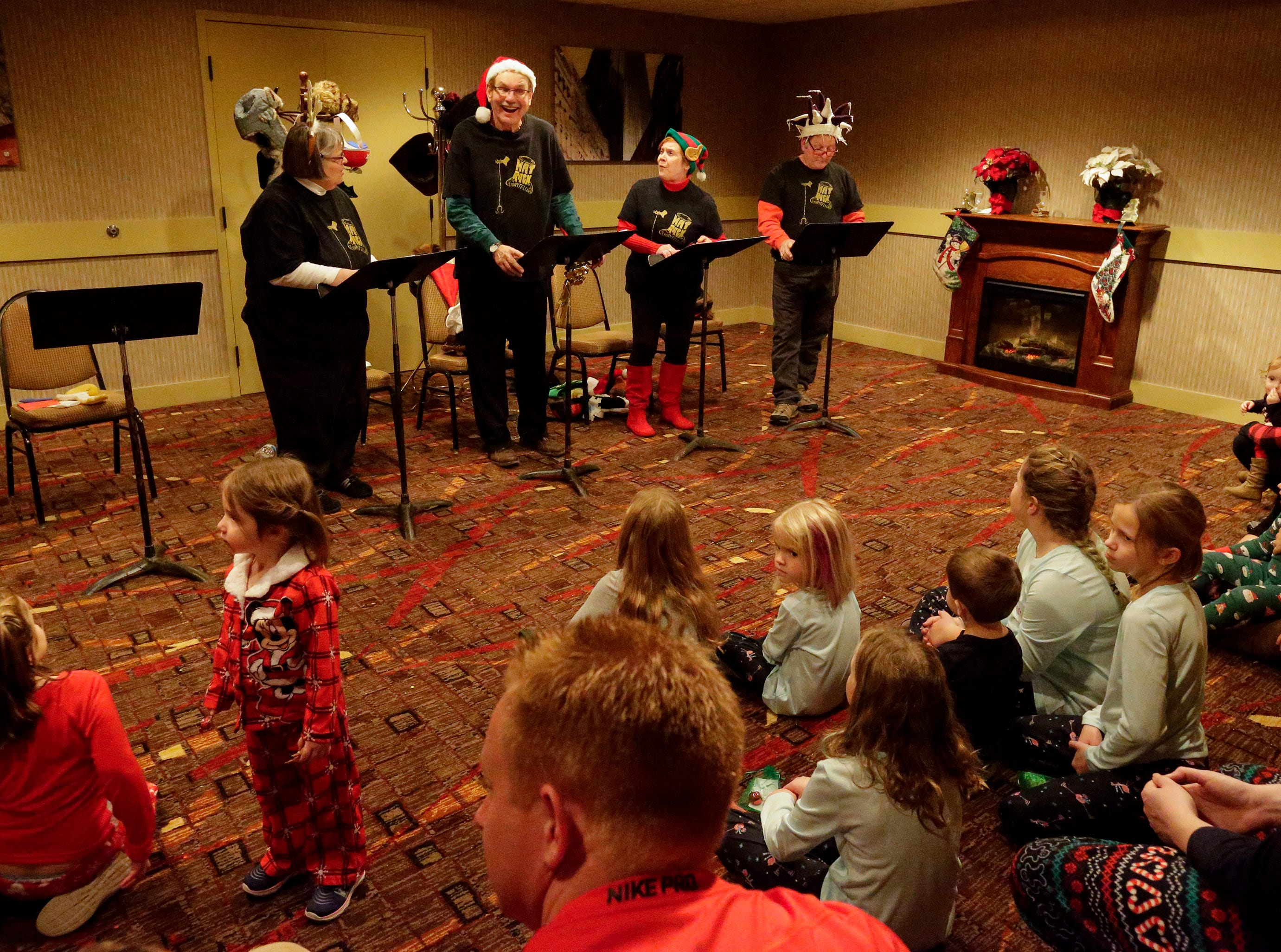 The Hat Rack Storytellers read a story to the children at Santa's North Pole at the Holiday Inn Saturday, December 8, 2018, in Manitowoc, Wis. Joshua Clark/USA TODAY NETWORK-Wisconsin