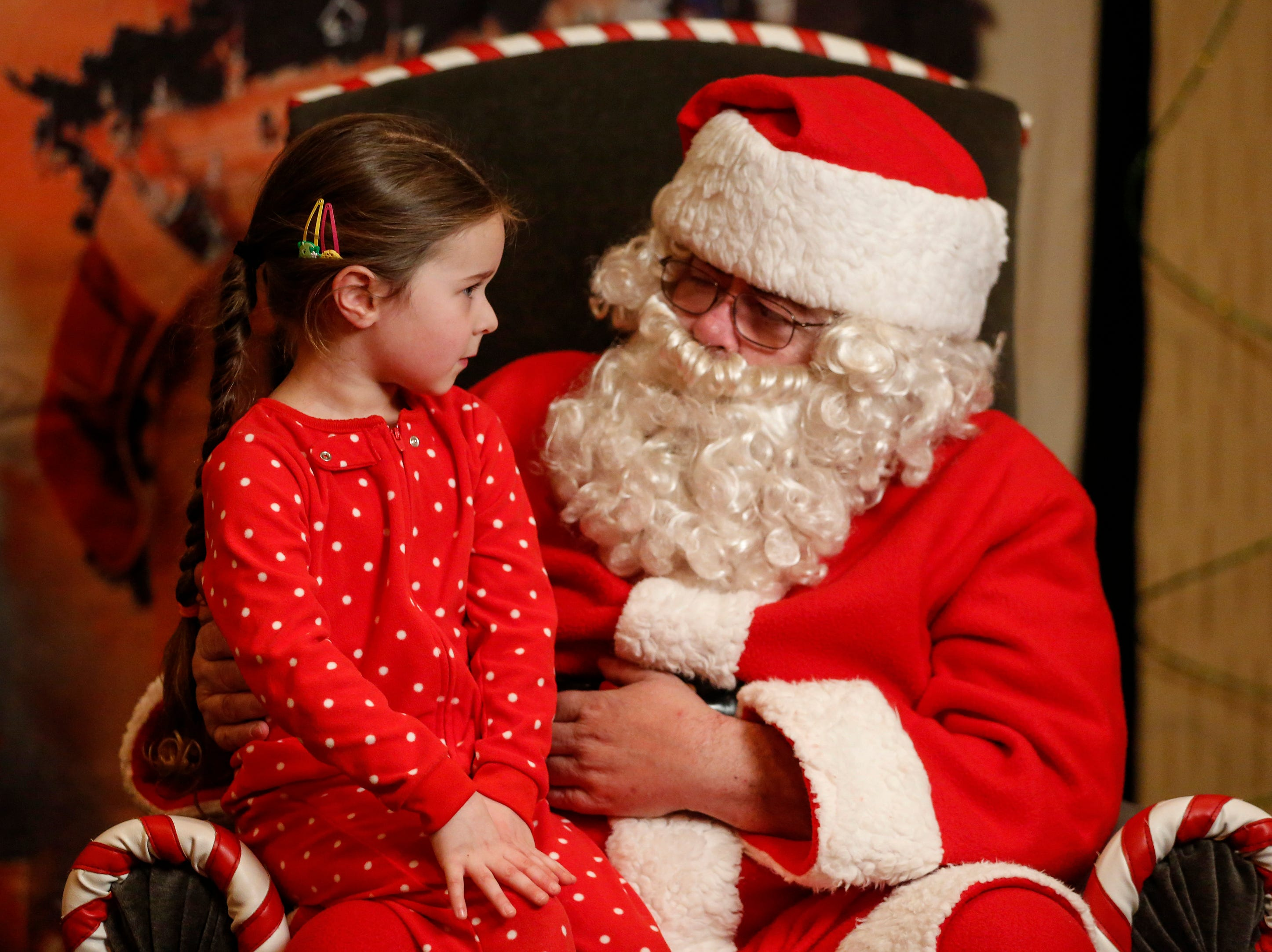 "Harper Garcia, 4, sits on Santa's lap at Santa's North Pole at the Holiday Inn Saturday, December 8, 2018, in Manitowoc, Wis. Children were taken to the Holiday Inn in a ""magical"" trolley to see visit Santa's North Pole. Proceeds from the event went to Lakeshore CAP. Joshua Clark/USA TODAY NETWORK-Wisconsin"