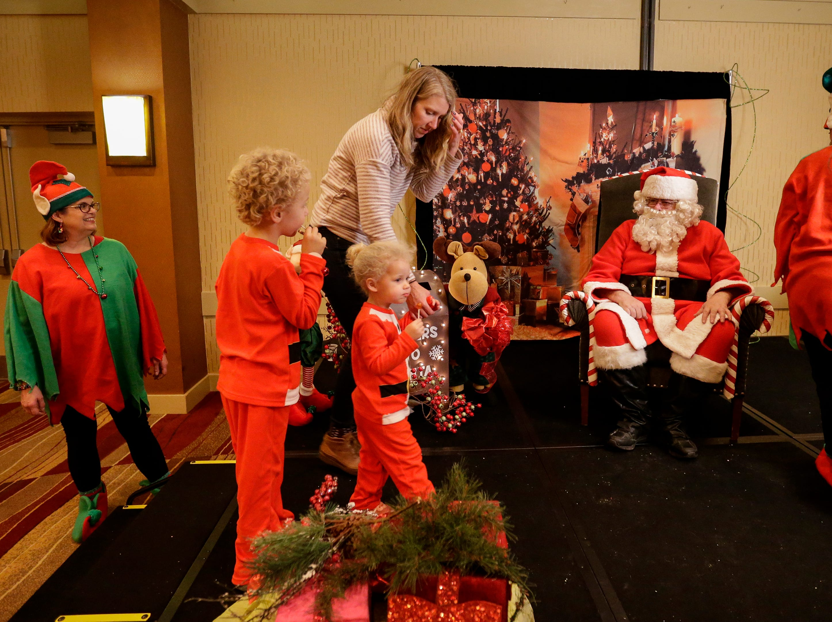 Molly Kafka takes Teddy, 5, and Edith, 2, Crain to visit Santa at Santa's North Pole at the Holiday Inn Saturday, December 8, 2018, in Manitowoc, Wis. Joshua Clark/USA TODAY NETWORK-Wisconsin