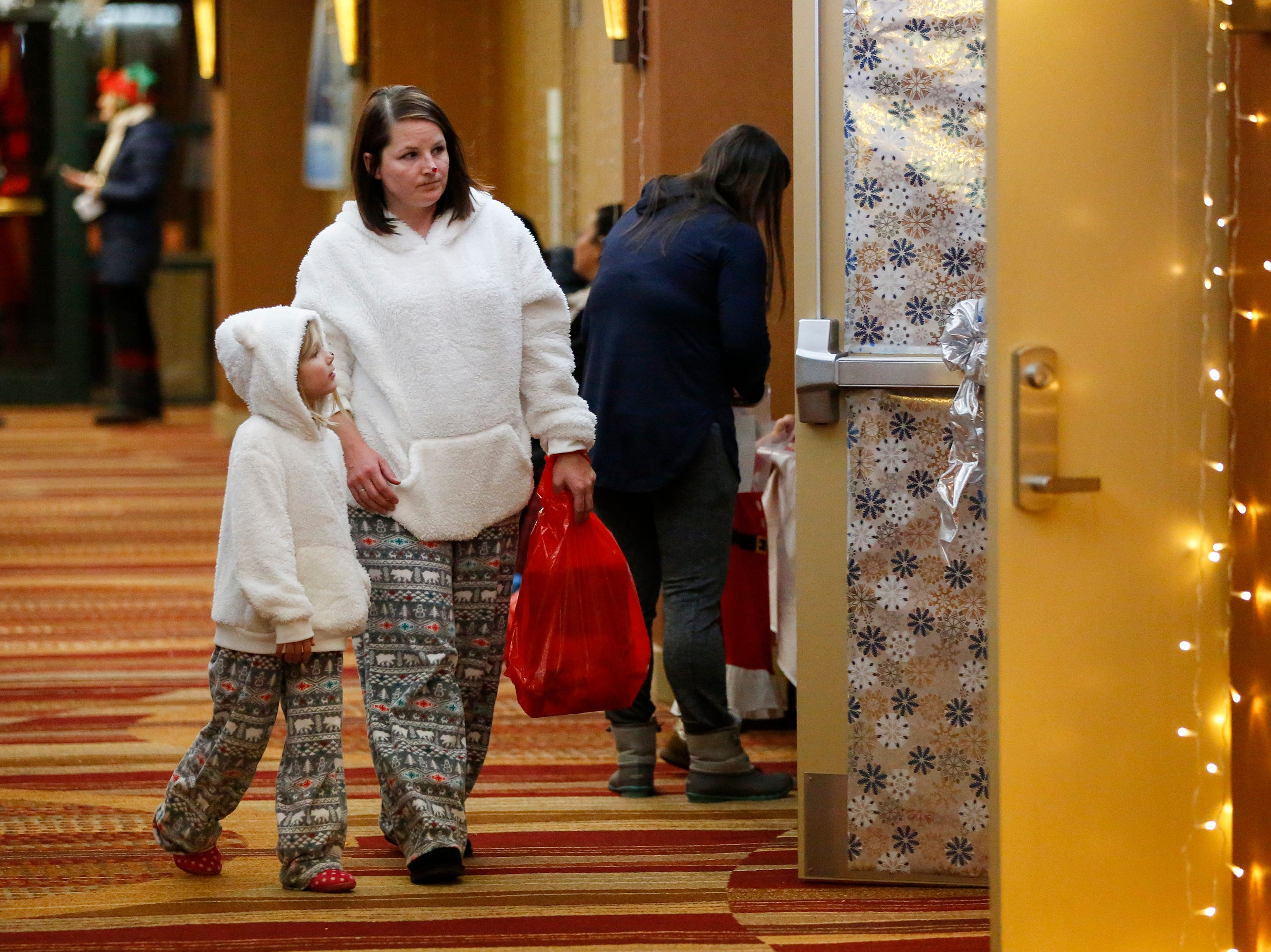 People make their way to Santa's workshop at Santa's North Pole at the Holiday Inn Saturday, December 8, 2018, in Manitowoc, Wis. Joshua Clark/USA TODAY NETWORK-Wisconsin