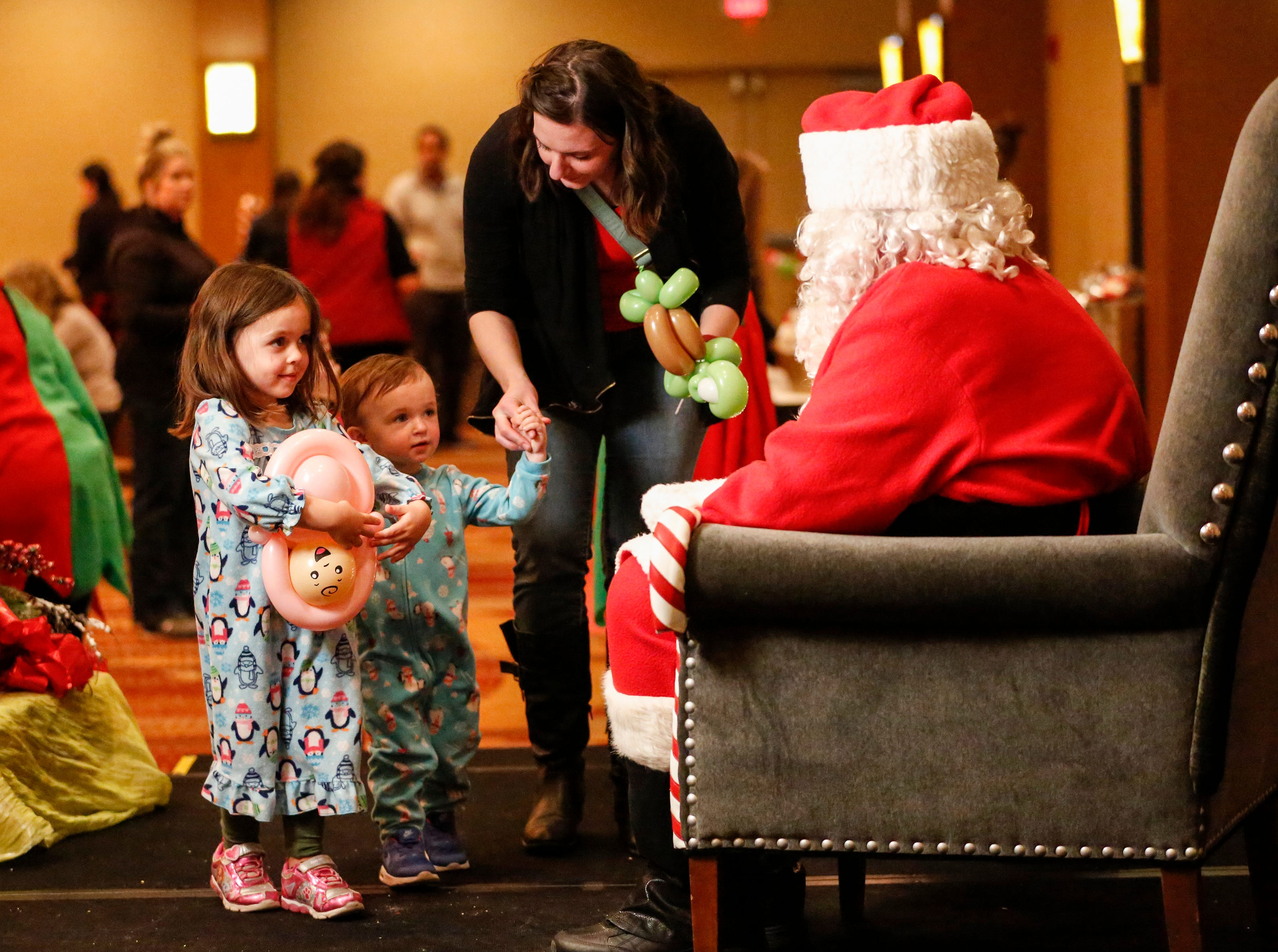 Erin Dach, of Jefferson, takes her children Harper, 4,  and Hattie, 2, to meet Santa at Santa's North Pole at the Holiday Inn Saturday, December 8, 2018, in Manitowoc, Wis. Joshua Clark/USA TODAY NETWORK-Wisconsin