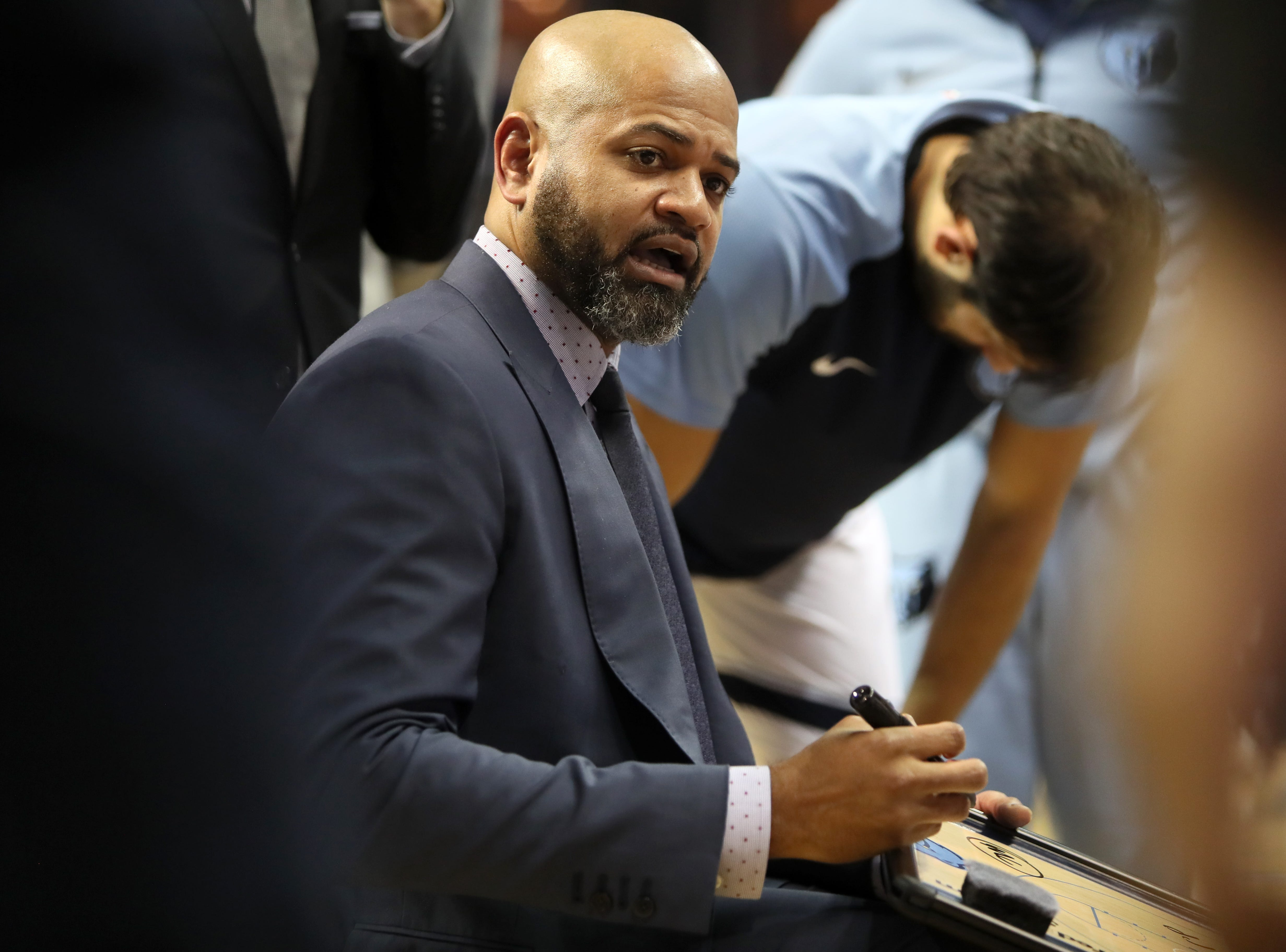 Memphis Grizzlies Head Coach J.B. Bickerstaff draws up a play in the huddle during their game against the Los Angeles Lakers at the FedExForum on Saturday, Dec. 8, 2018.