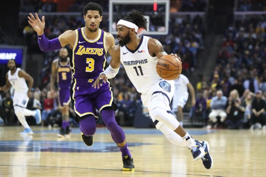 Memphis Grizzlies guard Mike Conley drives past Los Angeles Lakers defender Josh Hart at the FedExForum on Saturday, Dec. 6, 2018.