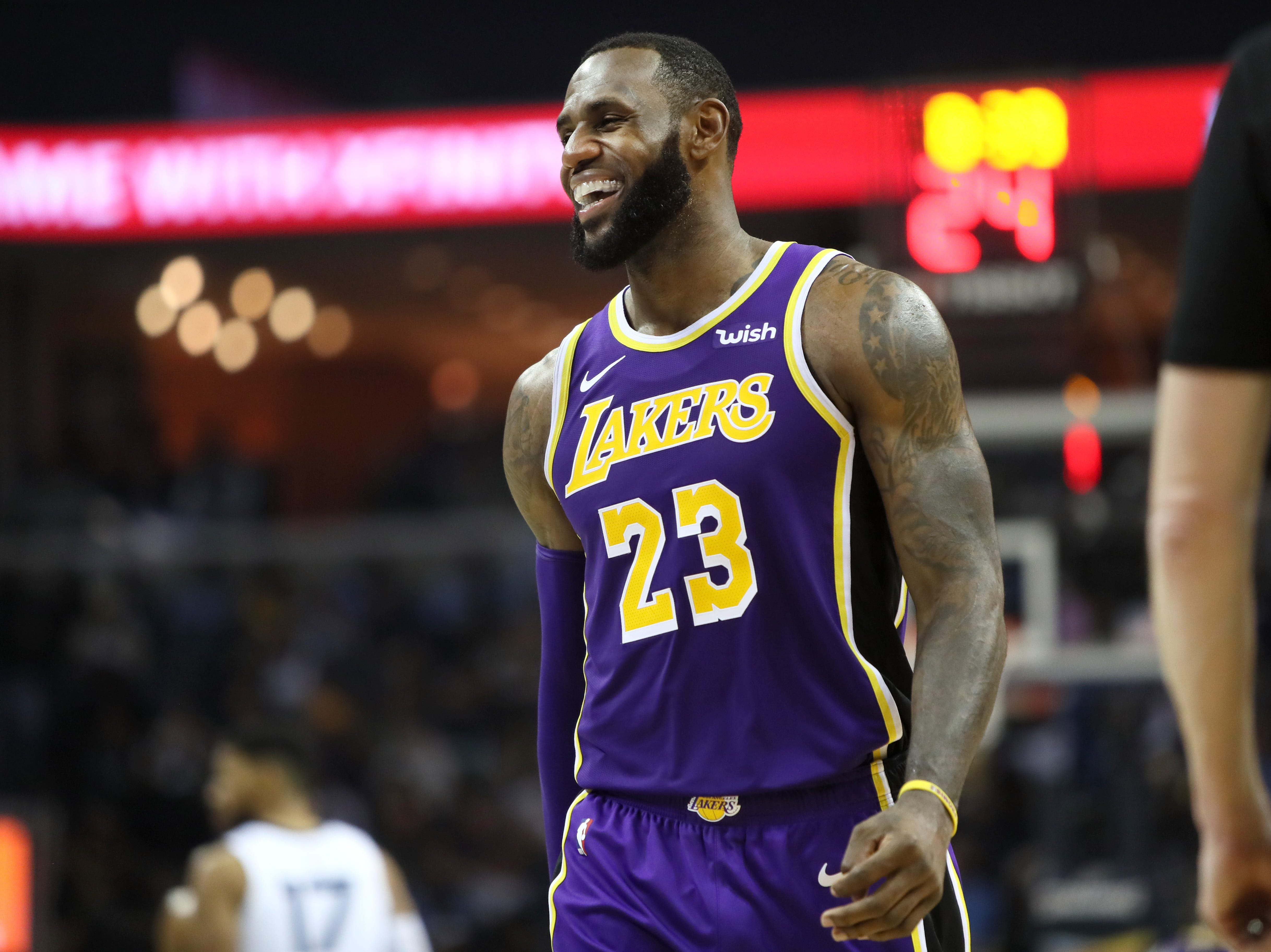 Los Angeles Lakers forward LeBron James smiles as his team takes on the Memphis Grizzlies at the FedExForum on Saturday, Dec. 8, 2018.